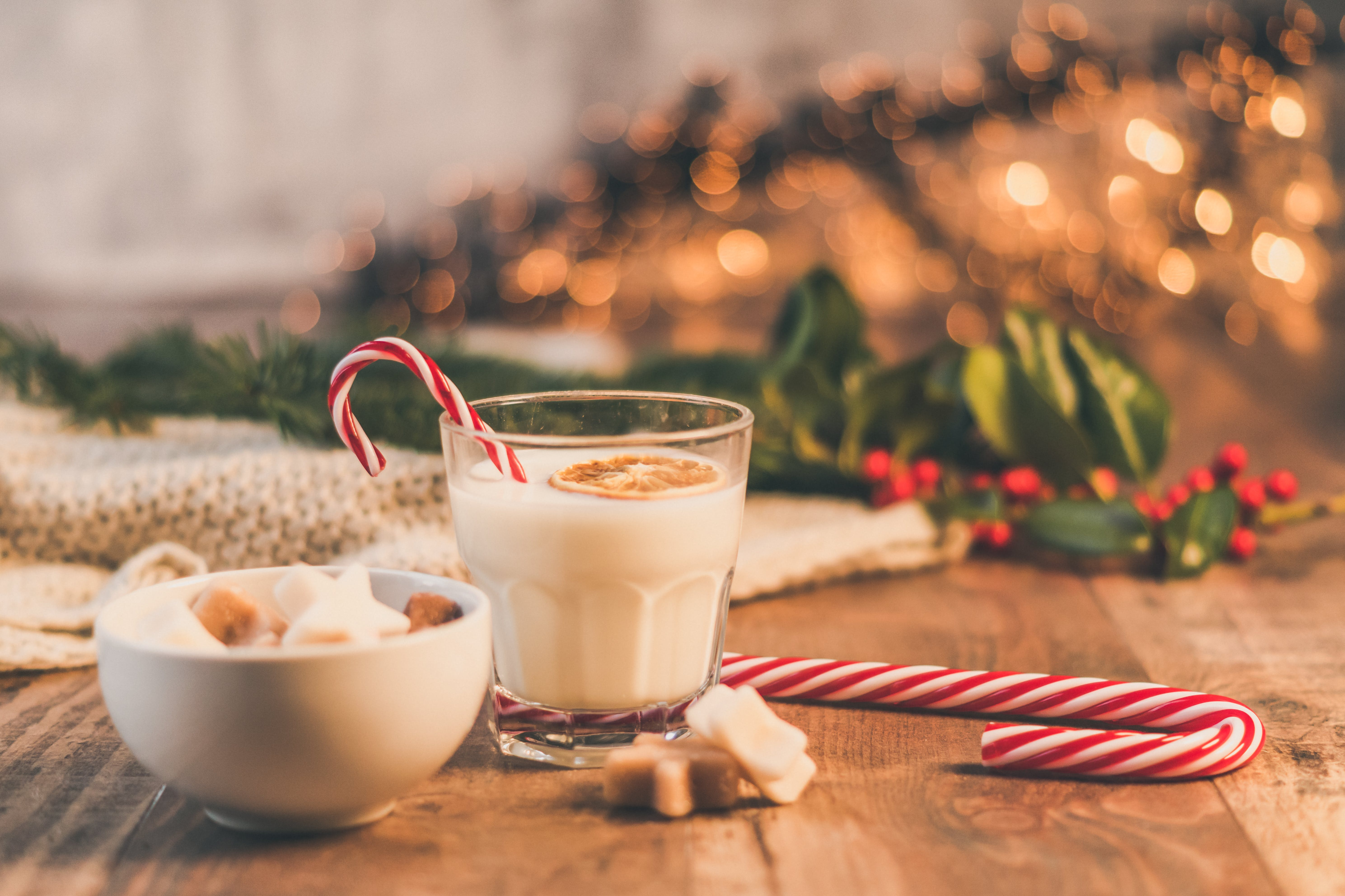 Clear Drinking Glass With Milk Near Candy Cane