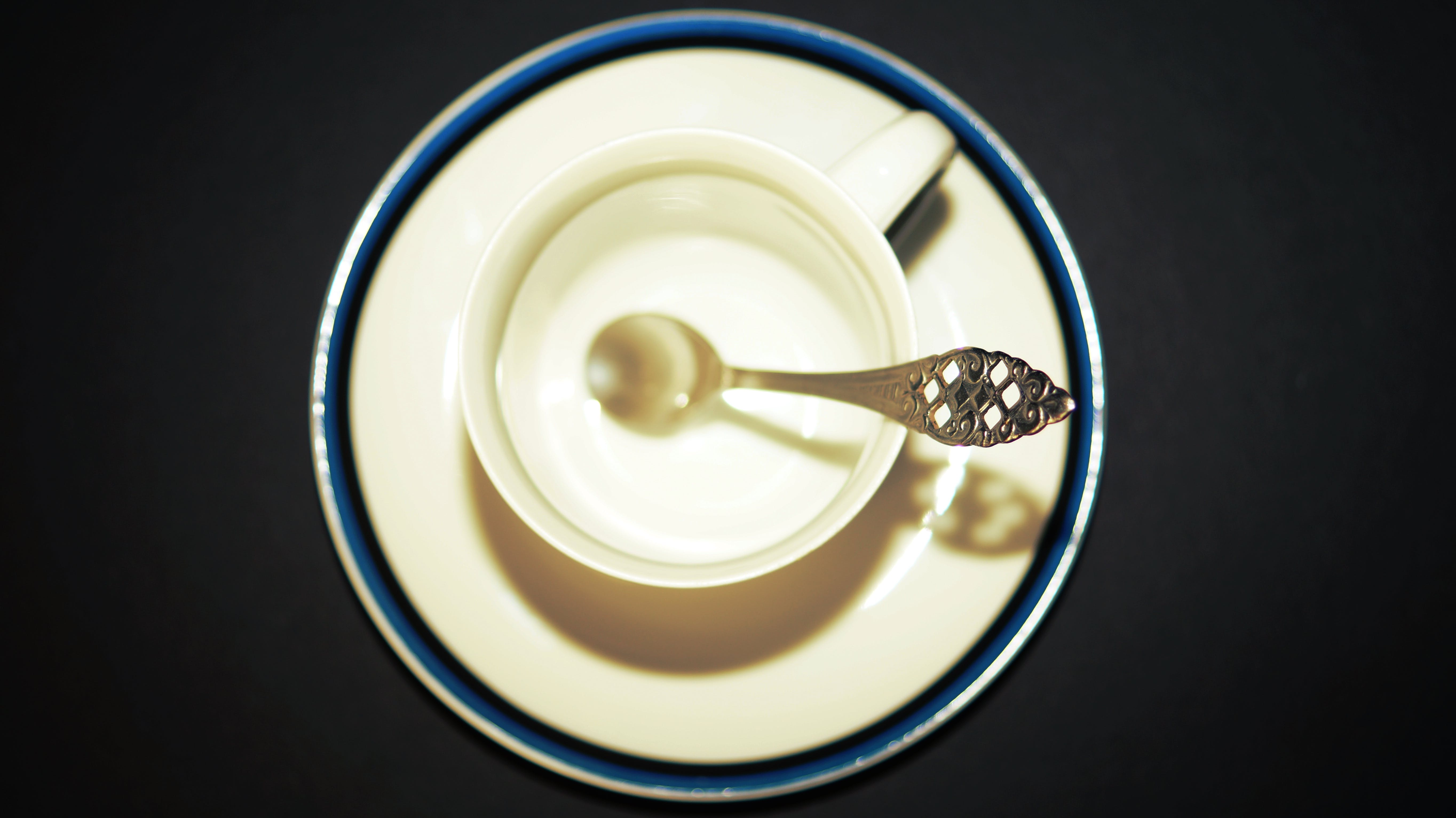 Silver-colored Spoon Inside White Teacup