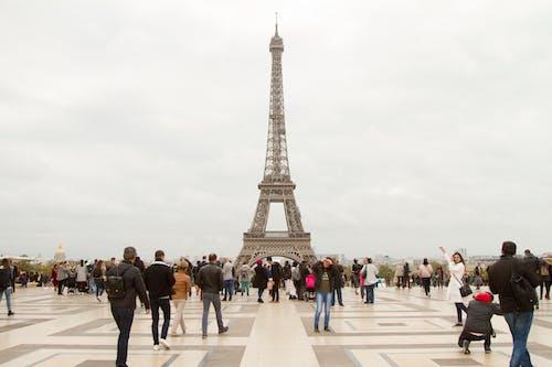 People Walking on Street Near Eiffel Tower