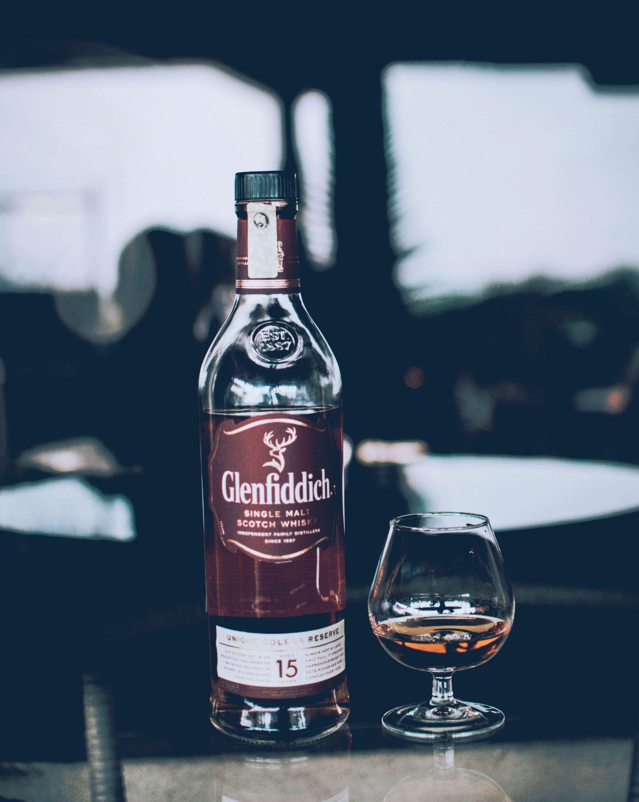 Glenfiddich Bottle Beside Wine Glass