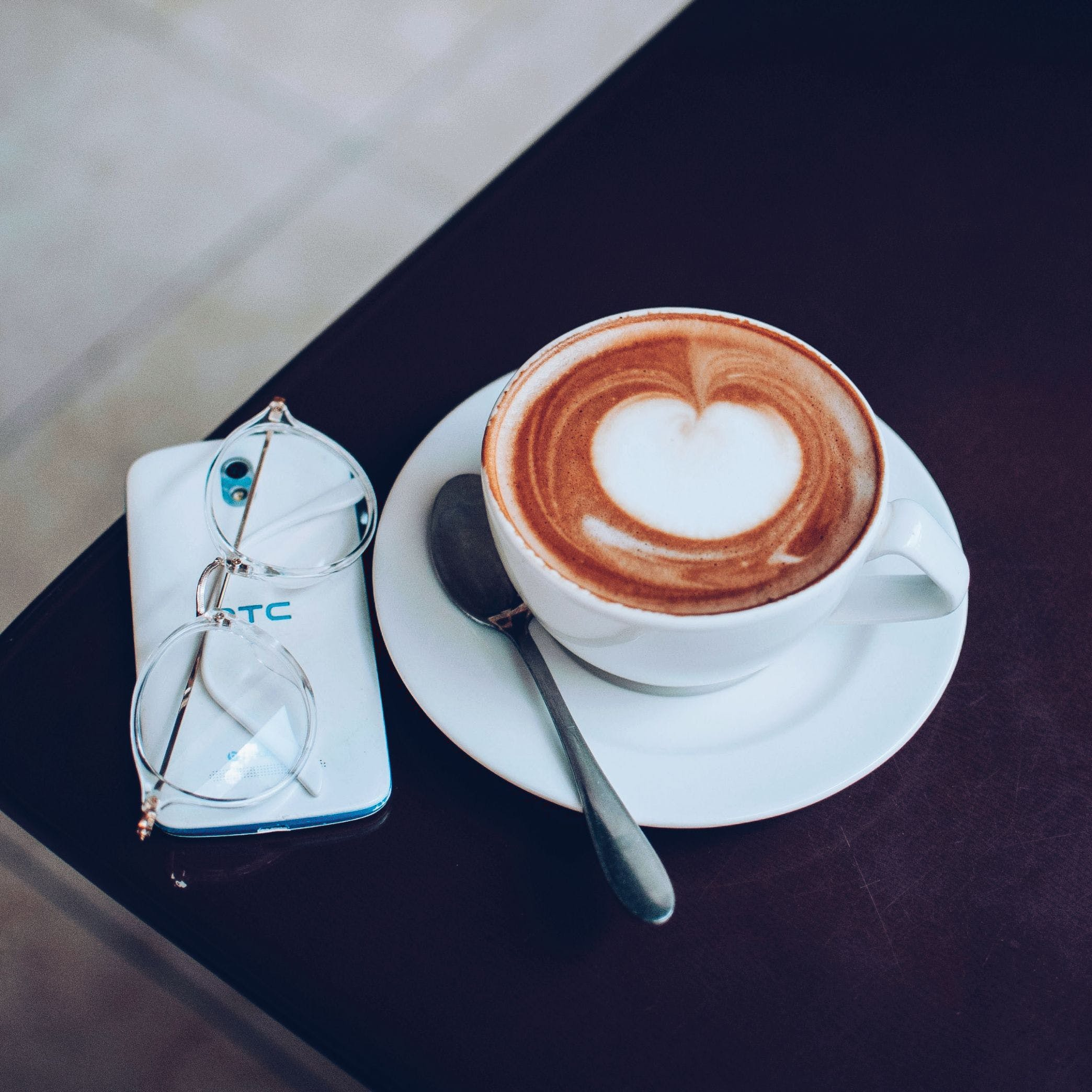 Espresso Cup Near Htc Smartphone