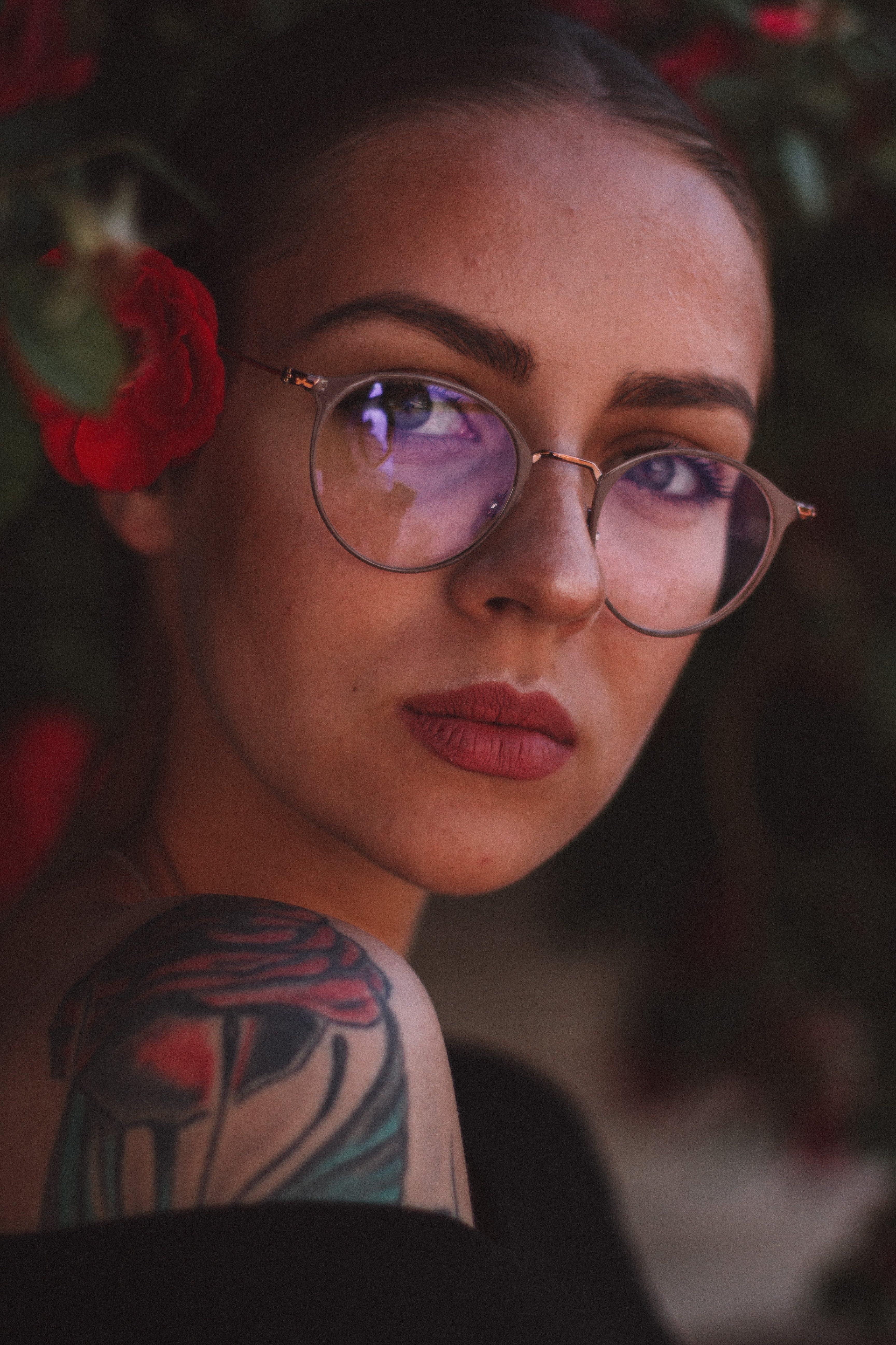 Close-Up Photo of Woman Wearing Eyeglasses