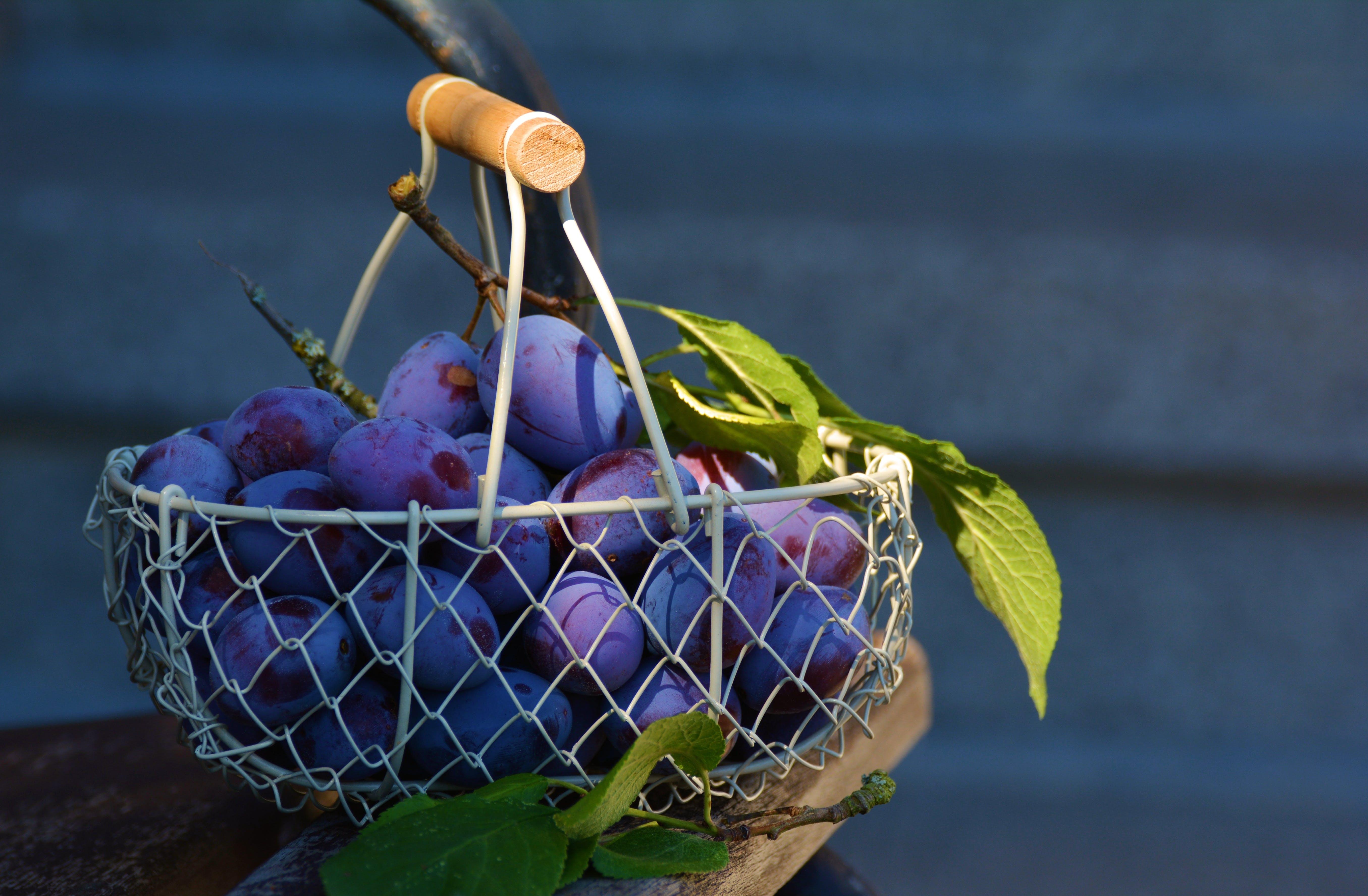 Red Grape Fruits on Metal Basket