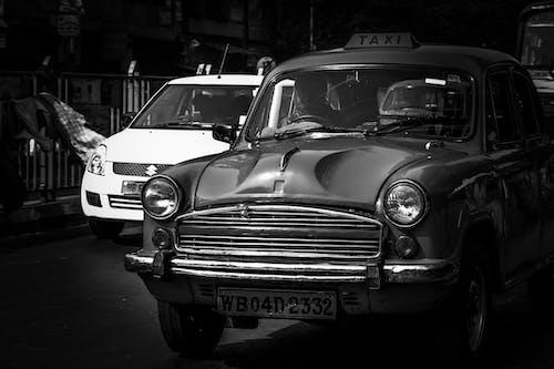 Бесплатное стоковое фото с автомобили, город, дорога, желтое такси