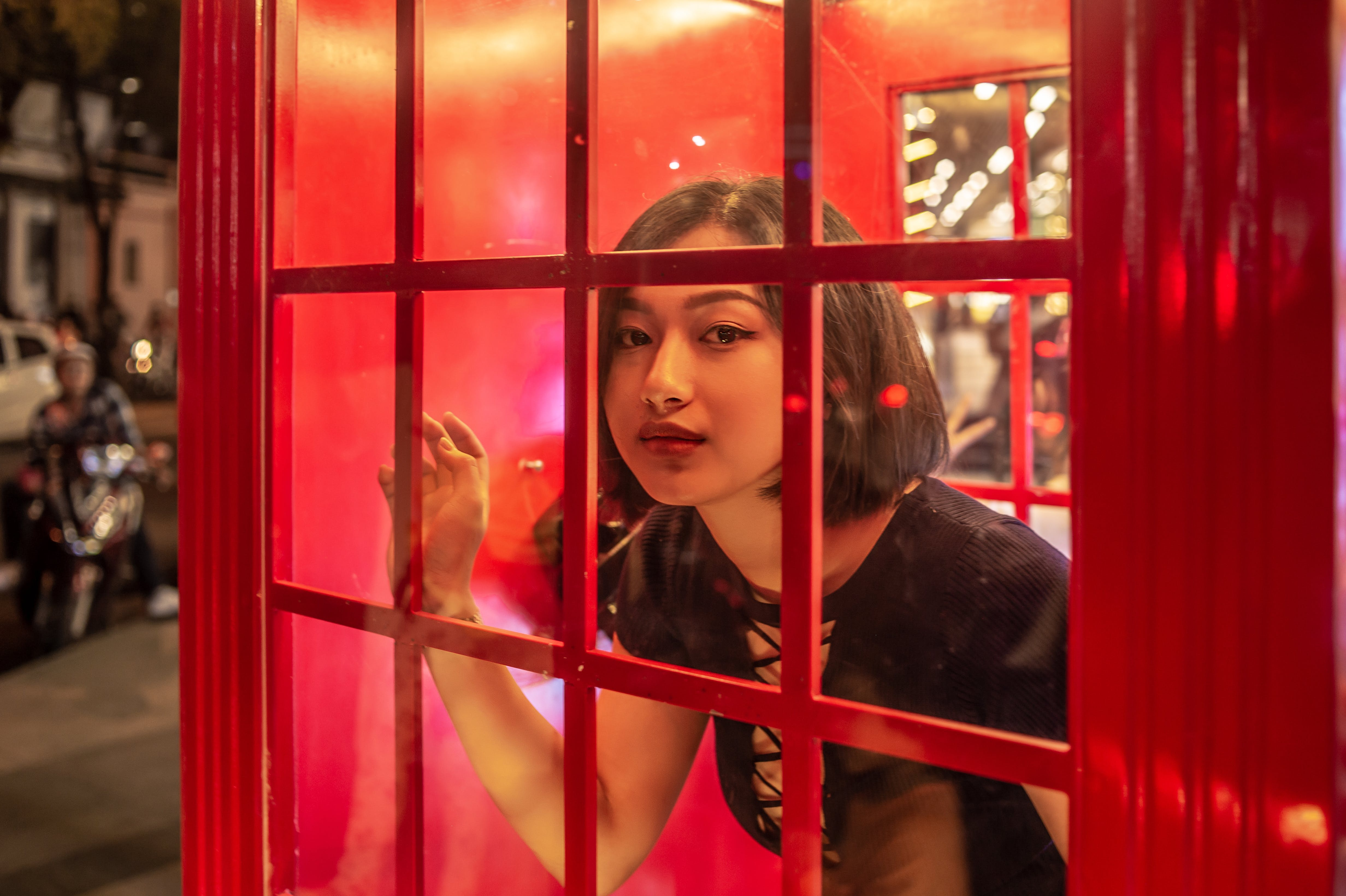 Woman Inside Red Telephone Booth