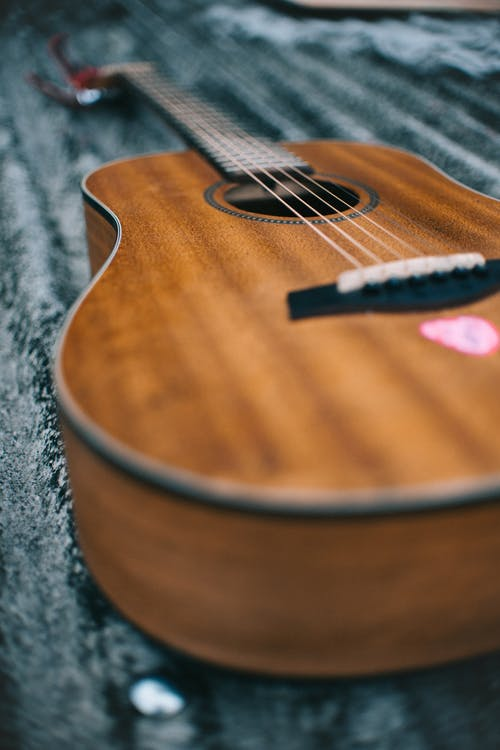 Selective Focus Photo of Guitar