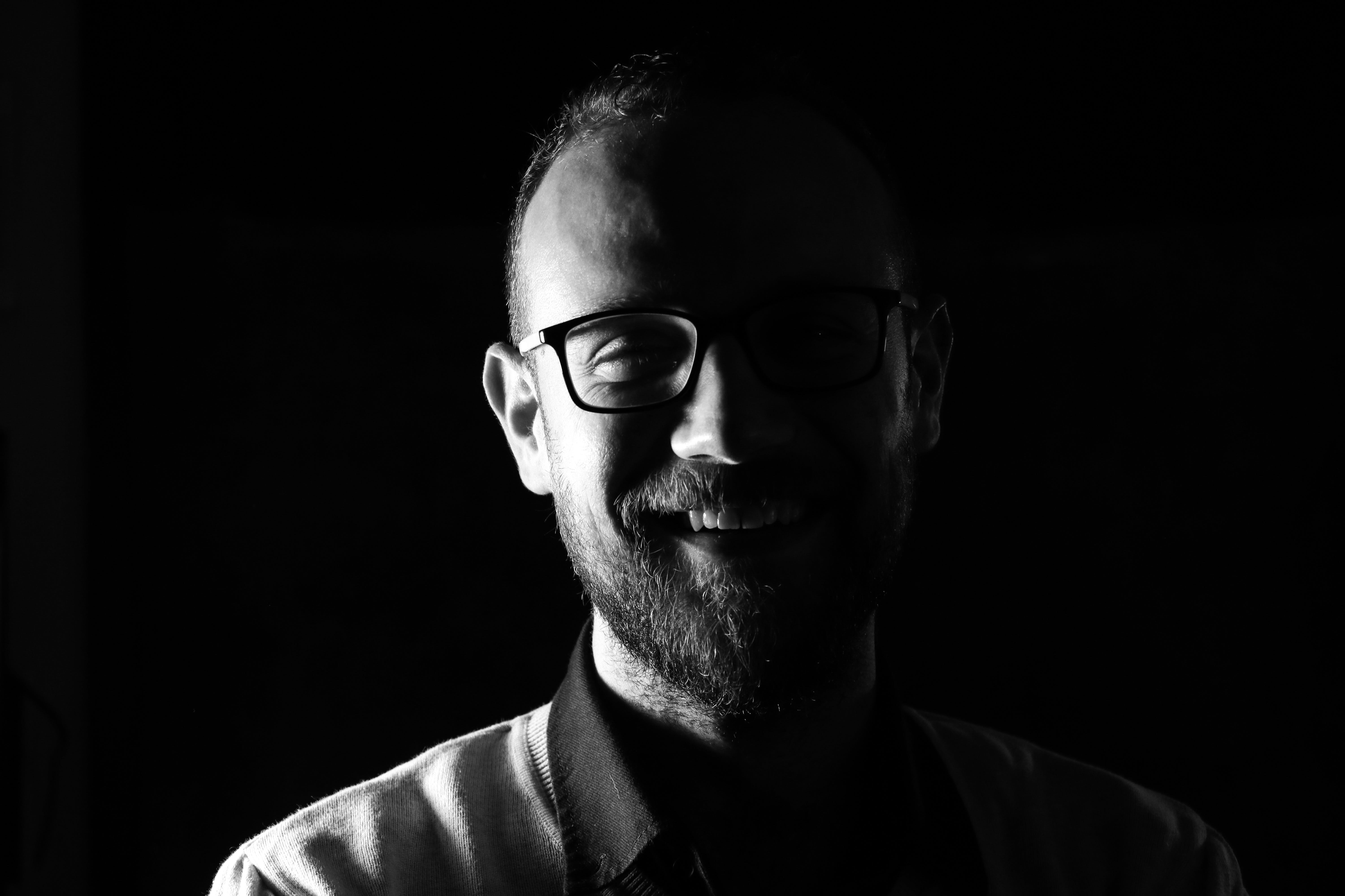 Grayscale Photo Of Smiling Man