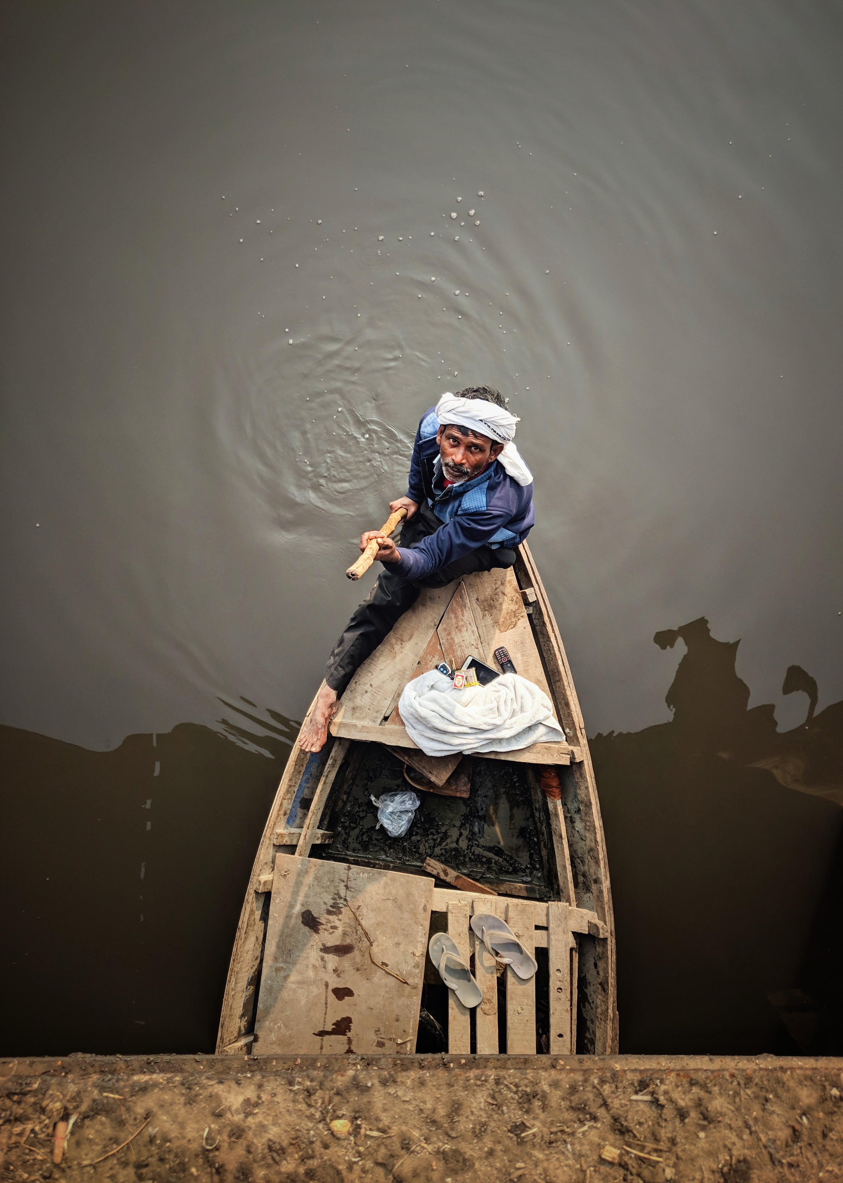 Man Holding Rod While Standing in Boat