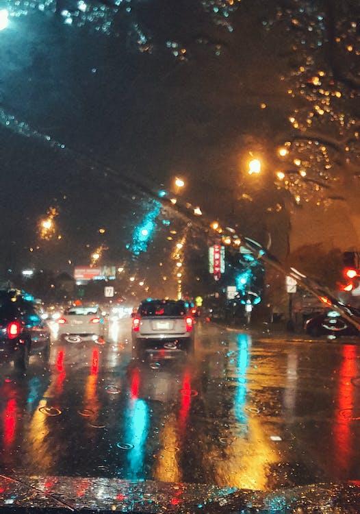 Cars Driving on Asphalt Road during Rainy Night