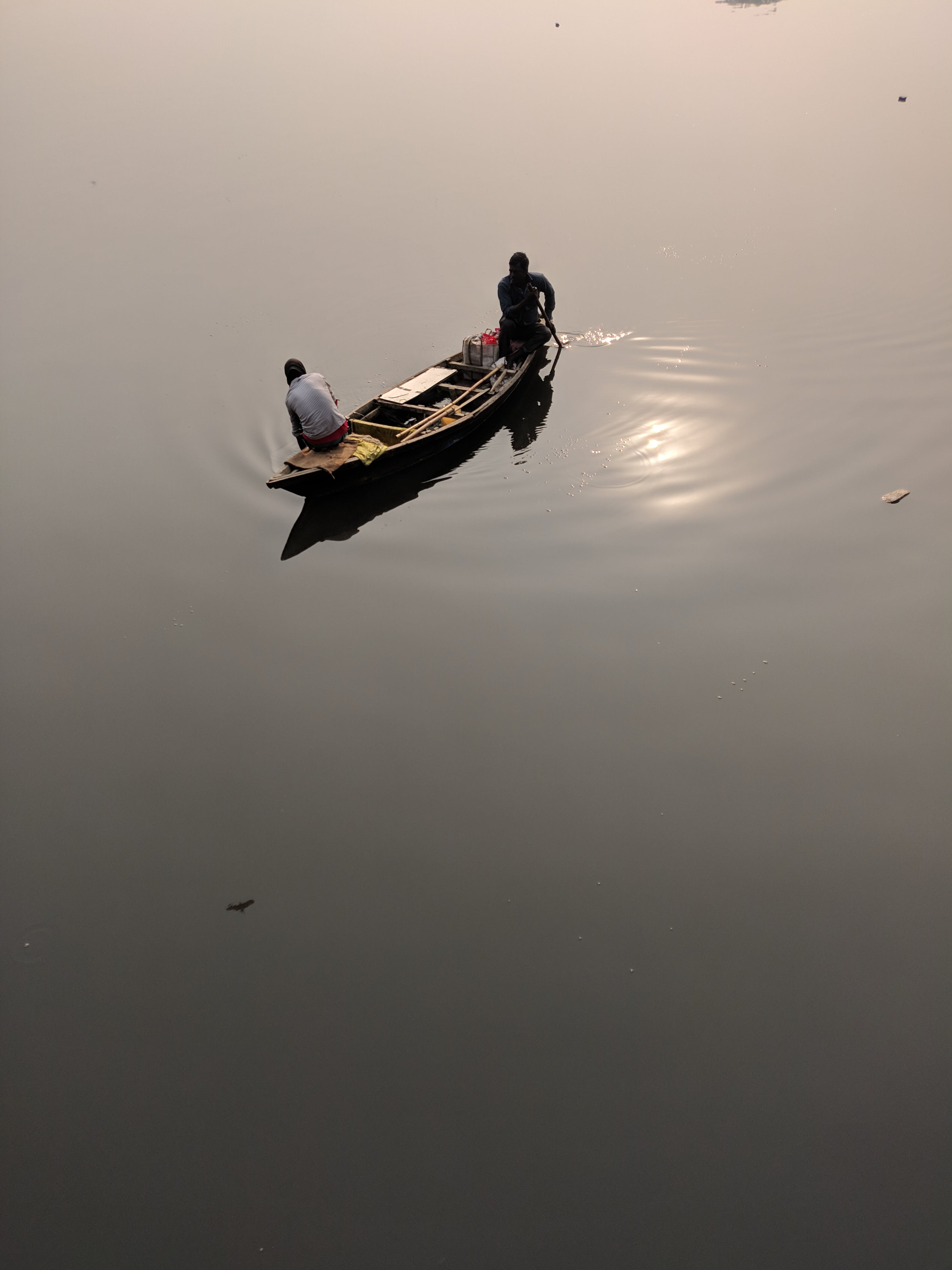 Two People Riding on Canoe during Daytime