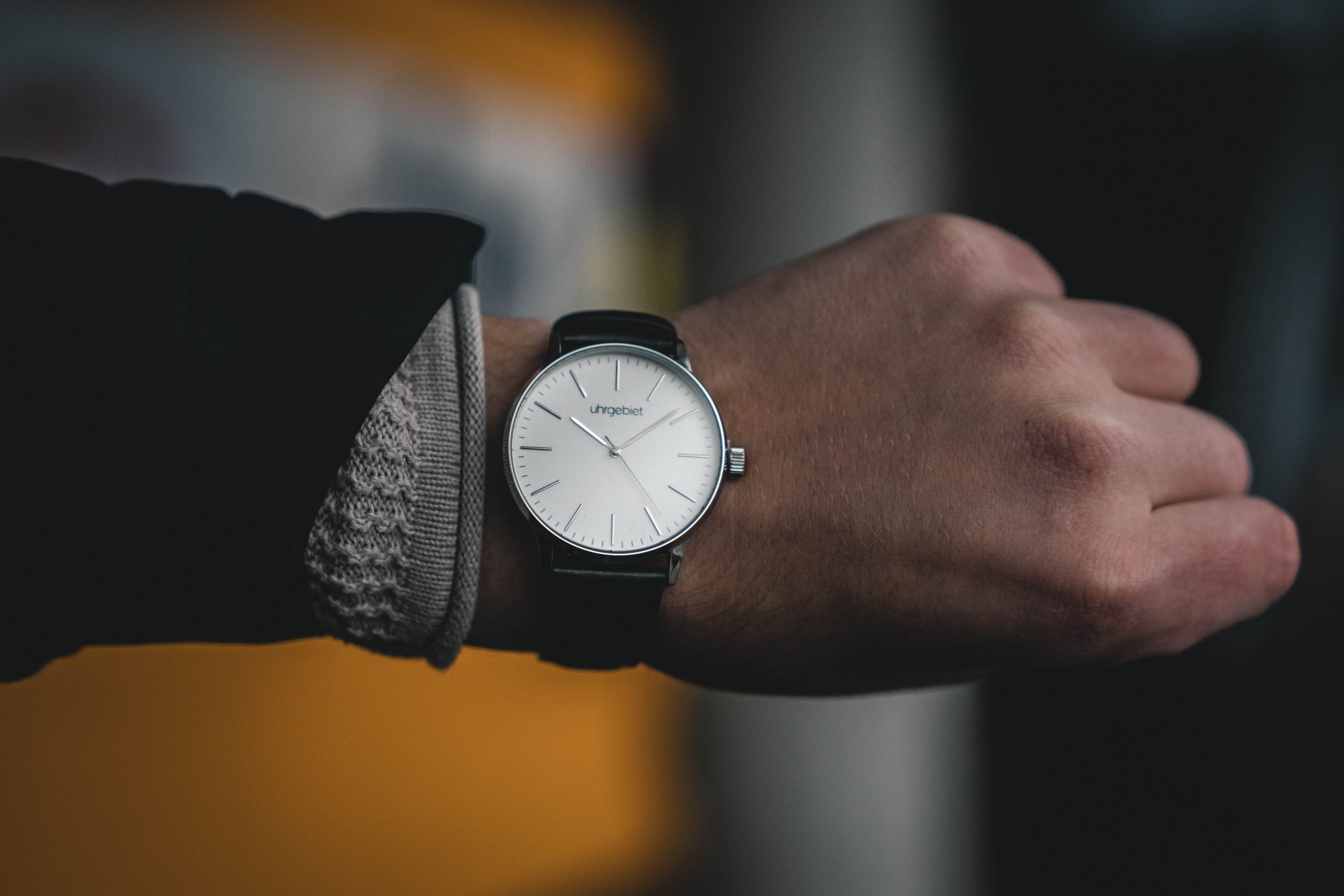 Person Wearing Round White Analog Watch at 10:09