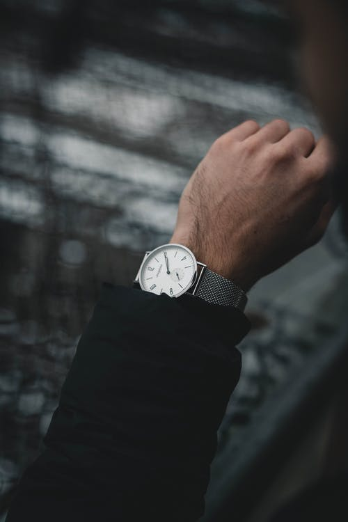 Person Wearing Round Analog Watch