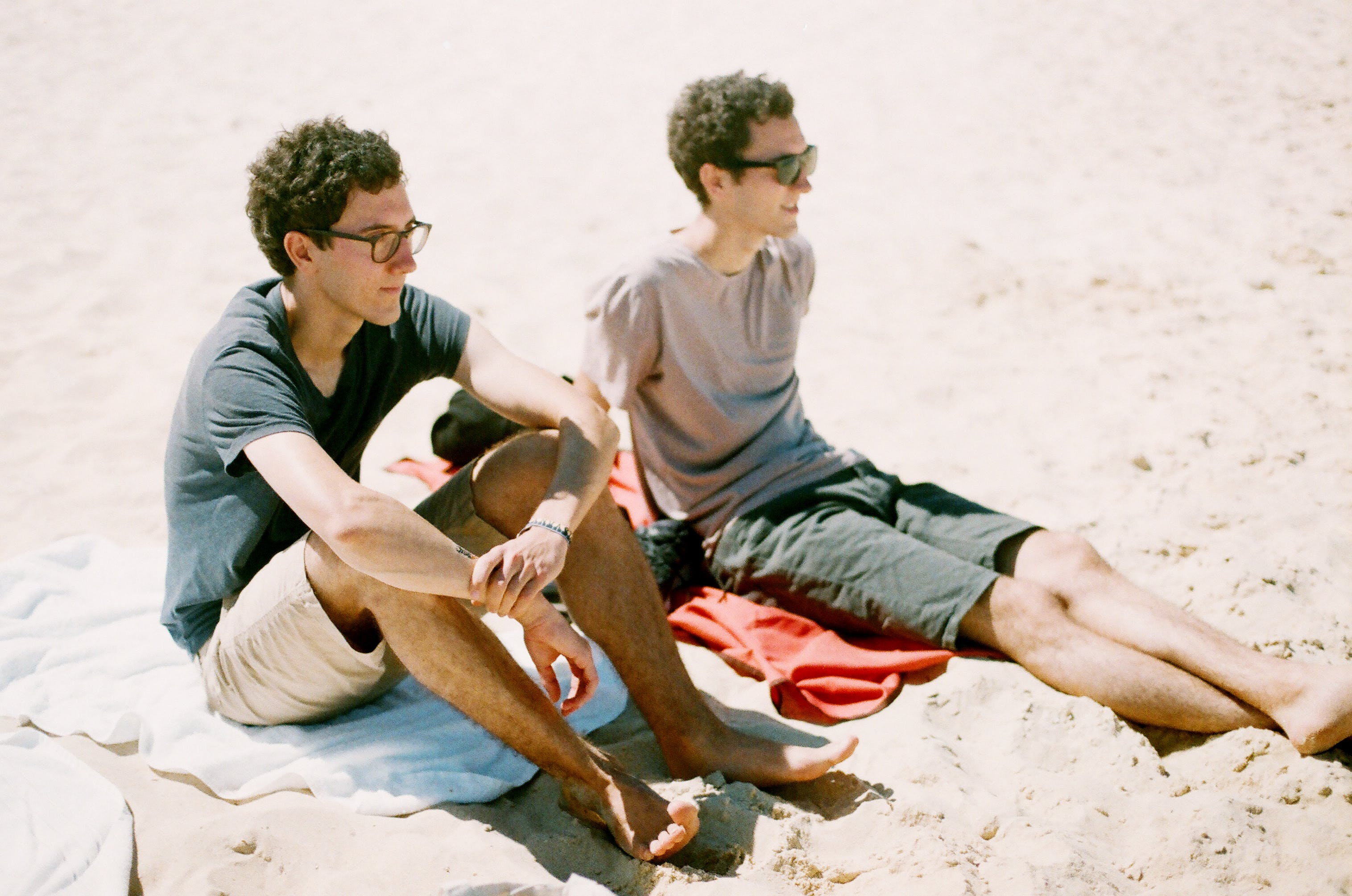 Two Guys Sitting by the Beach