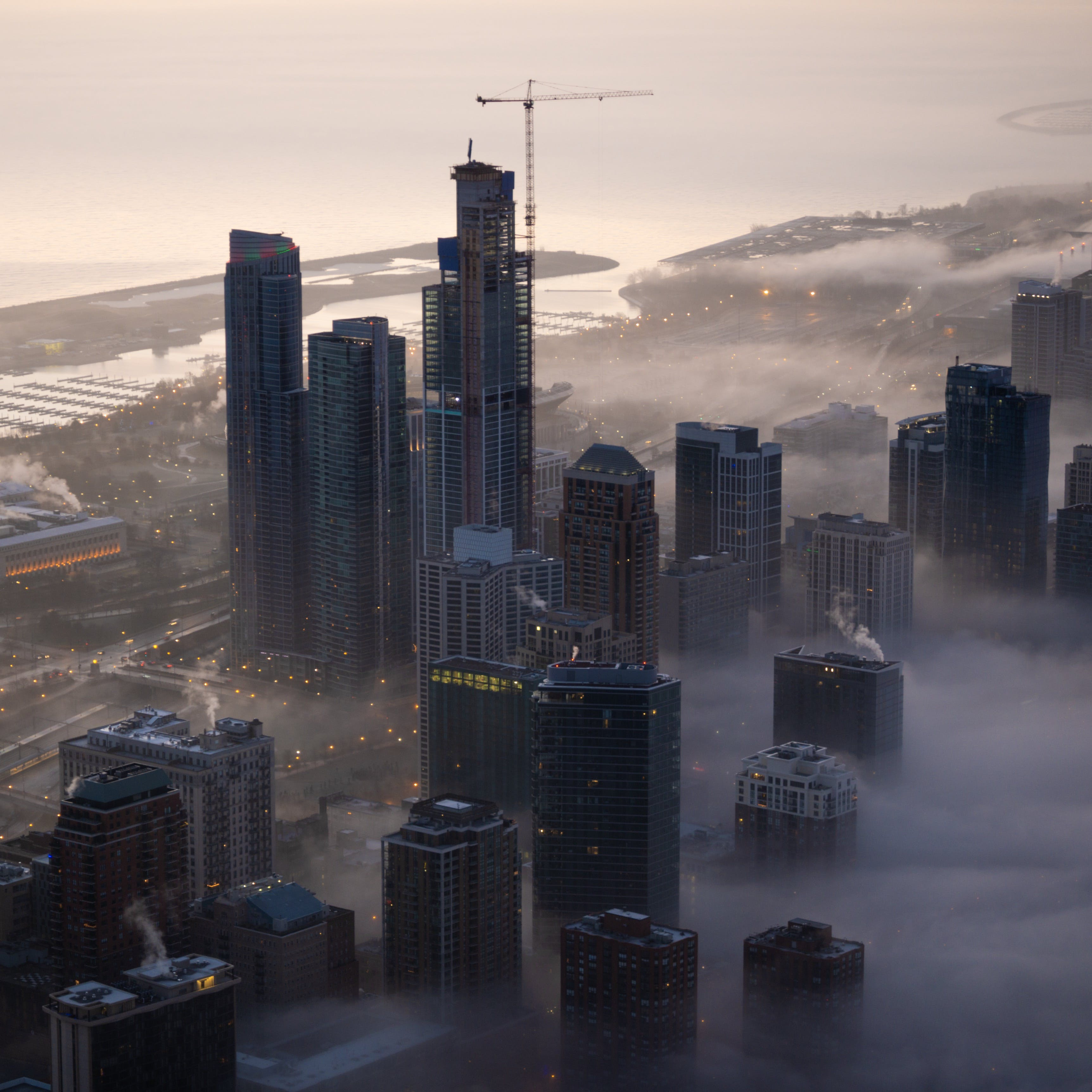 Aerial Photo of Cityscape Covered in Fog