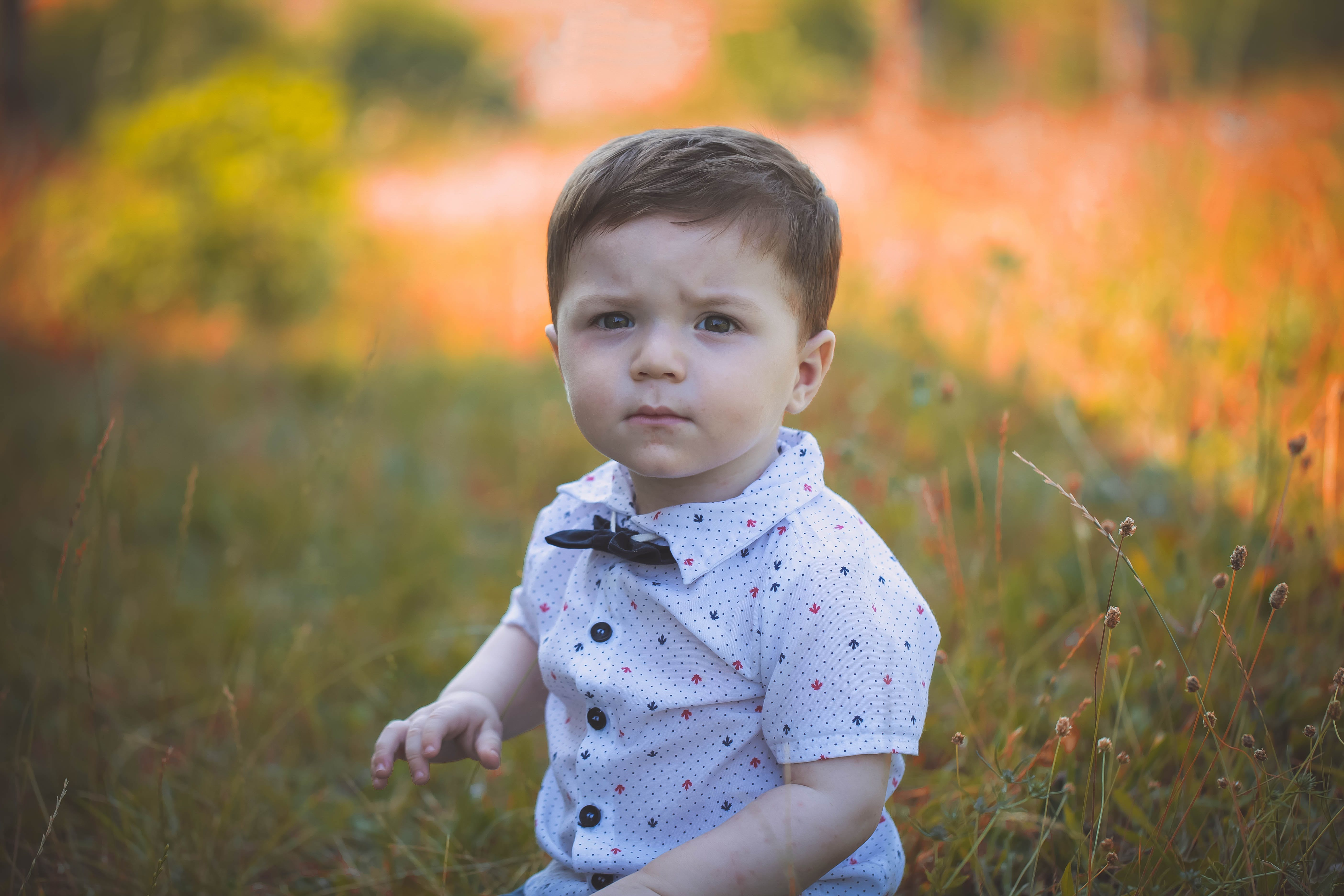 Selective Focus Photography of Toddler Wearing White Polo Shirt