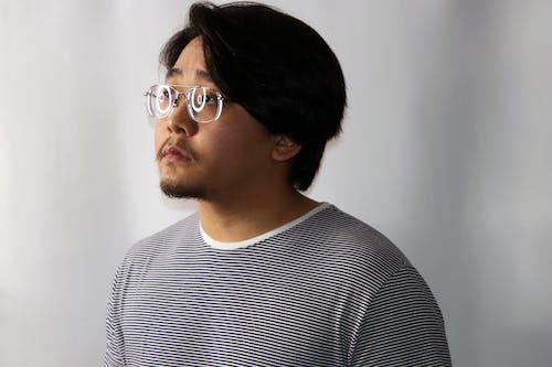 Gratis arkivbilde med ansiktshår, ansiktsuttrykk, asiatisk mann, asiatisk person