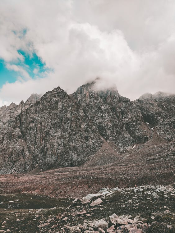 Photo of Rocky Mountain Under Cloudy Sky