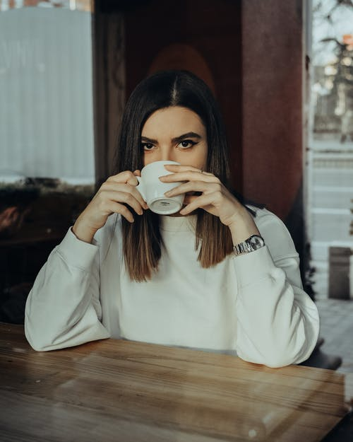 Photo of Woman Drinking on Cup