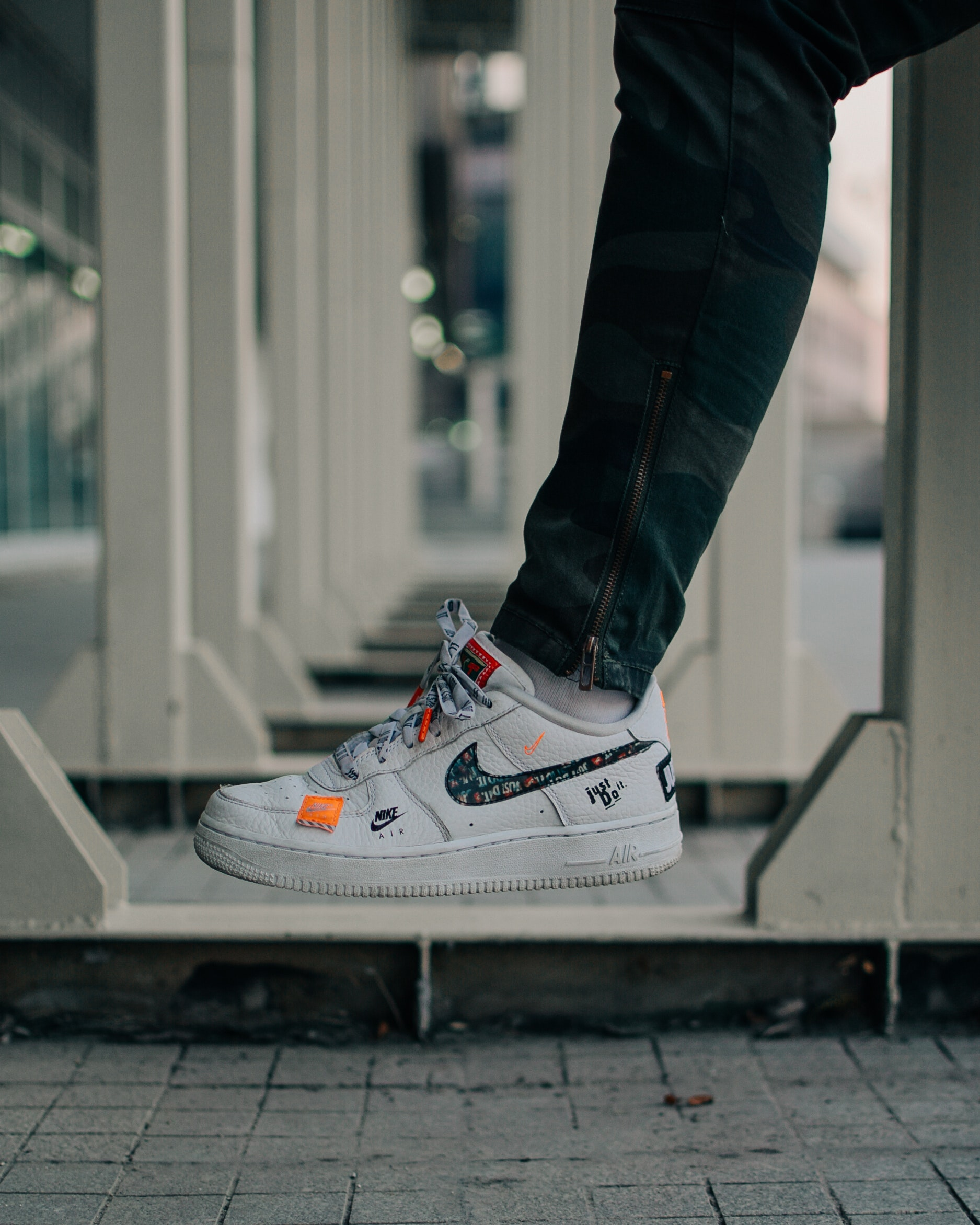 Selective Focus Photography Of Person Wearing Nike Air Force