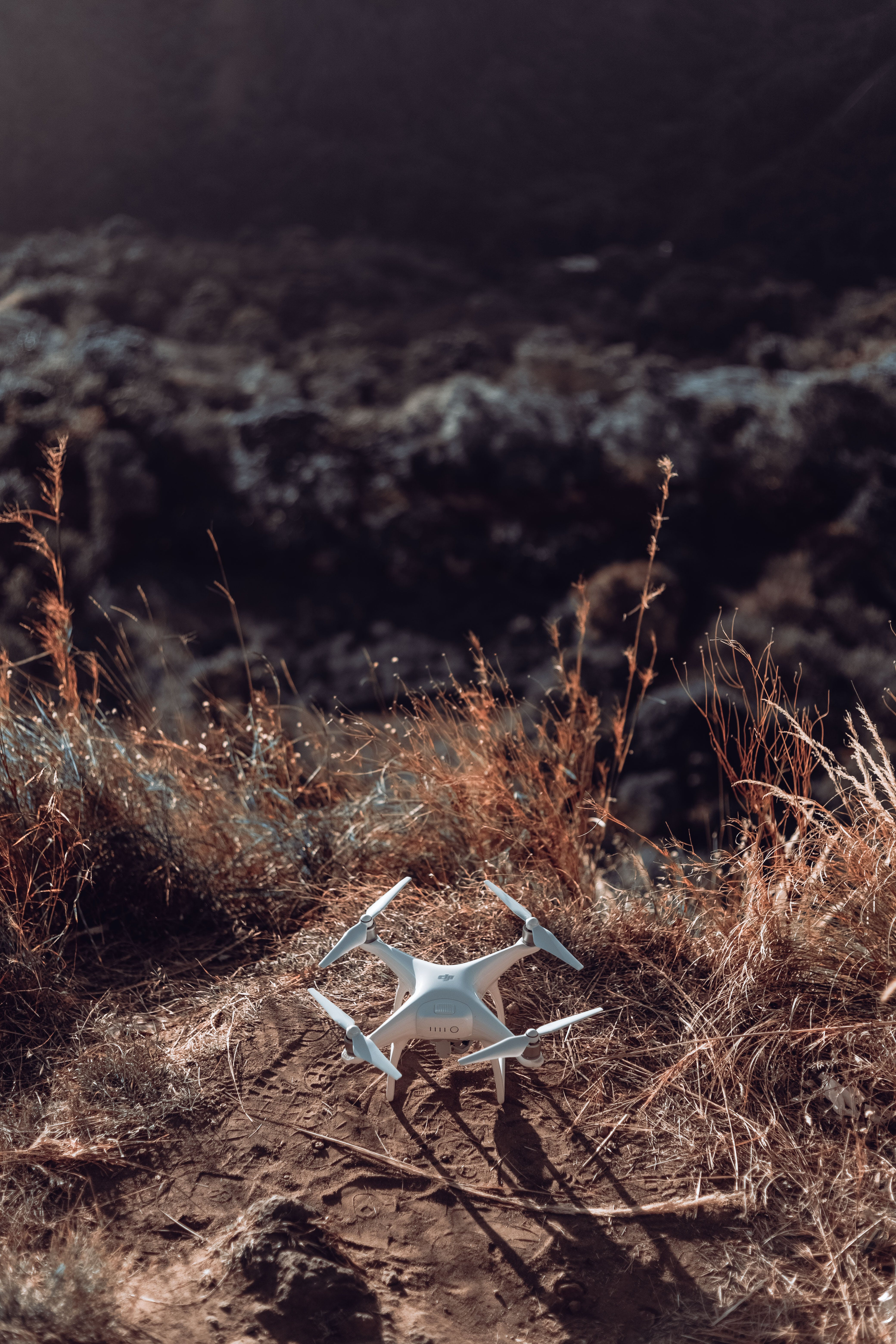 White Drone Quad Copter On Grass Field