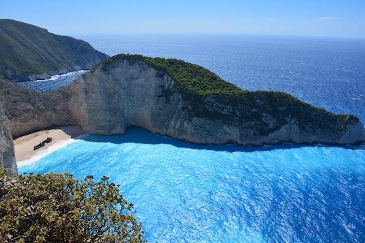 Green Island Near the Ocean during Daytime