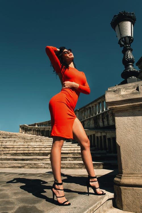 Woman in Red Long-sleeved Dress