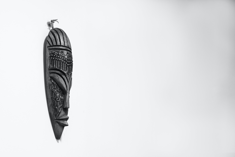 Black Wooden Tiki Mask on Wall