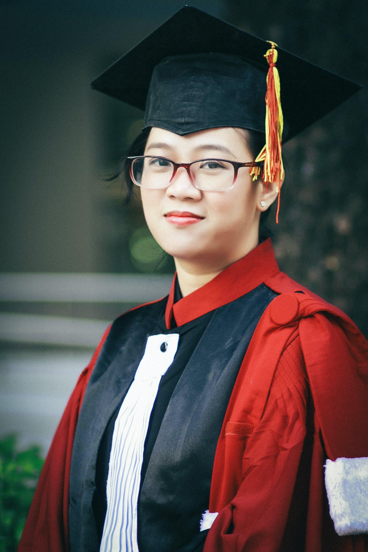 Photo of Woman Wearing Academic Dress