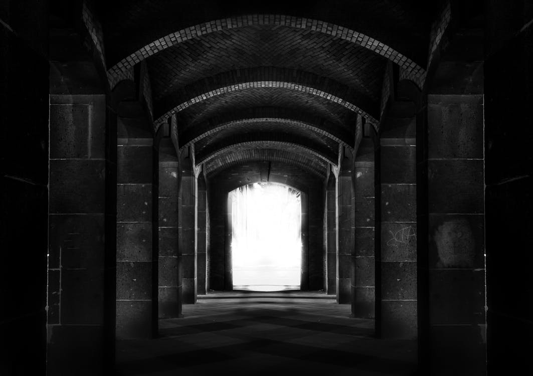 Black and White Photo of a Tunnel