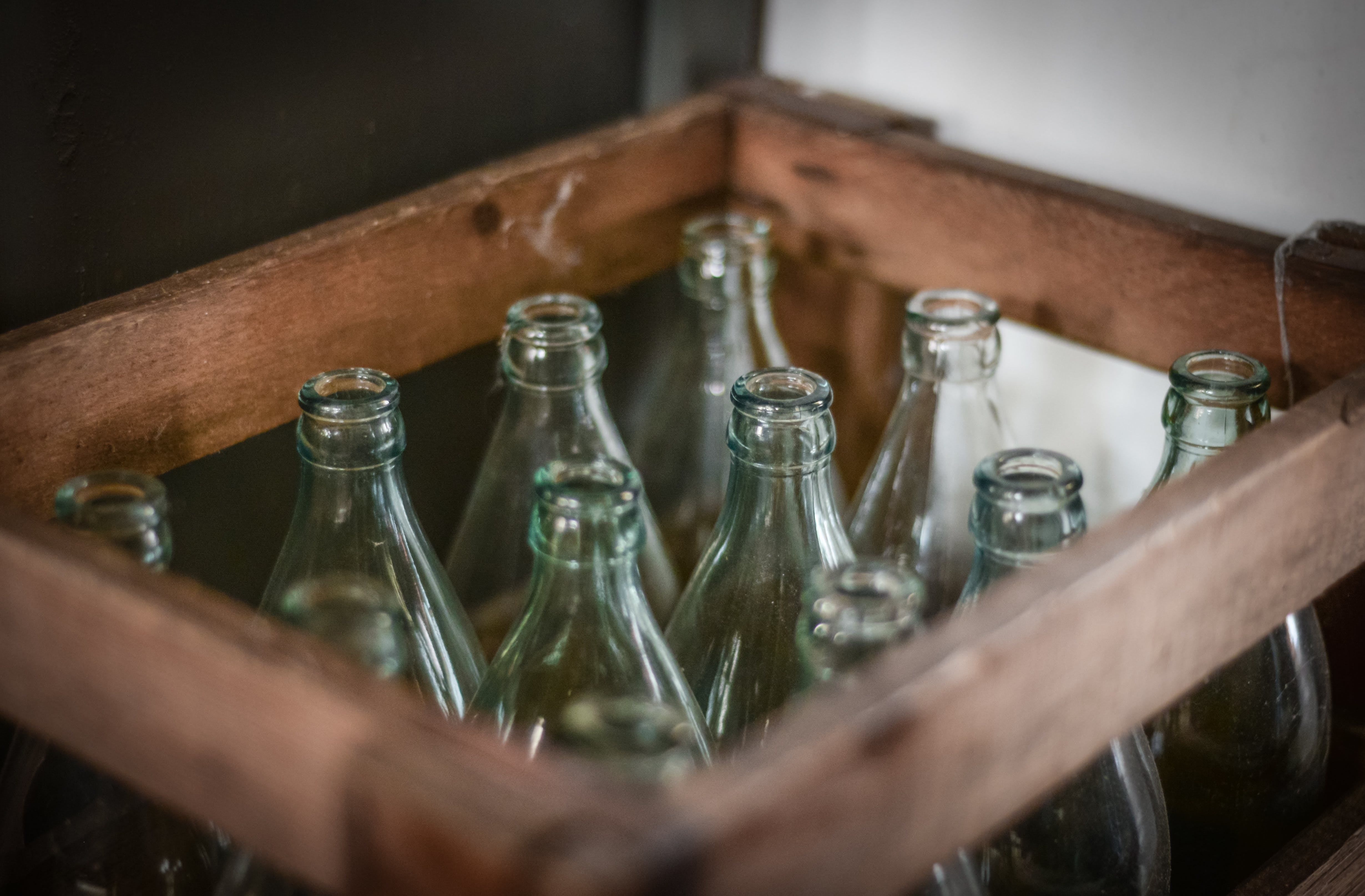 Photo of Bottles Inside Brown Wooden Crate