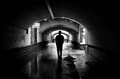 Silhouette Photo of a Man in a Tunnel