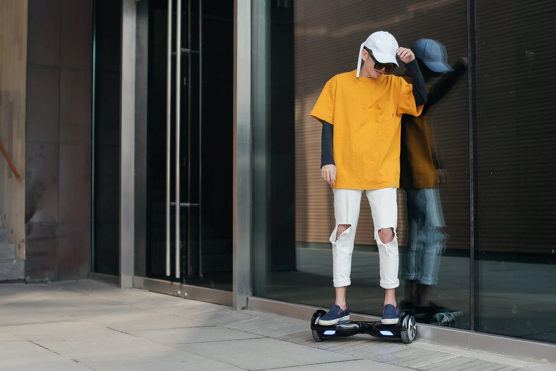 Teenager riding a hoverboard
