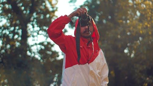 Gratis lagerfoto af fotograf, fotografi, frakke, handling