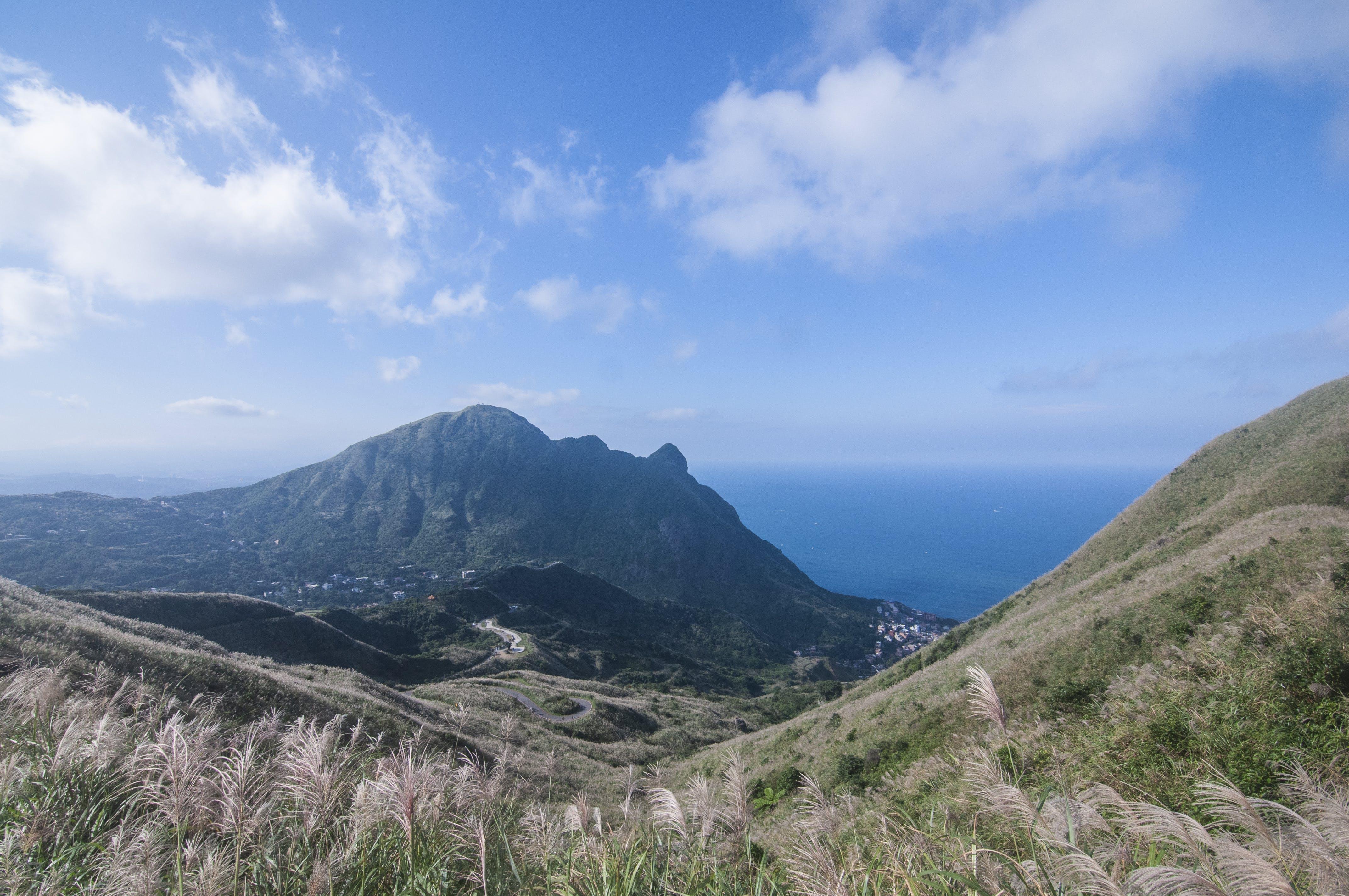Free stock photo of blue sky, cloud, mountain top, sea