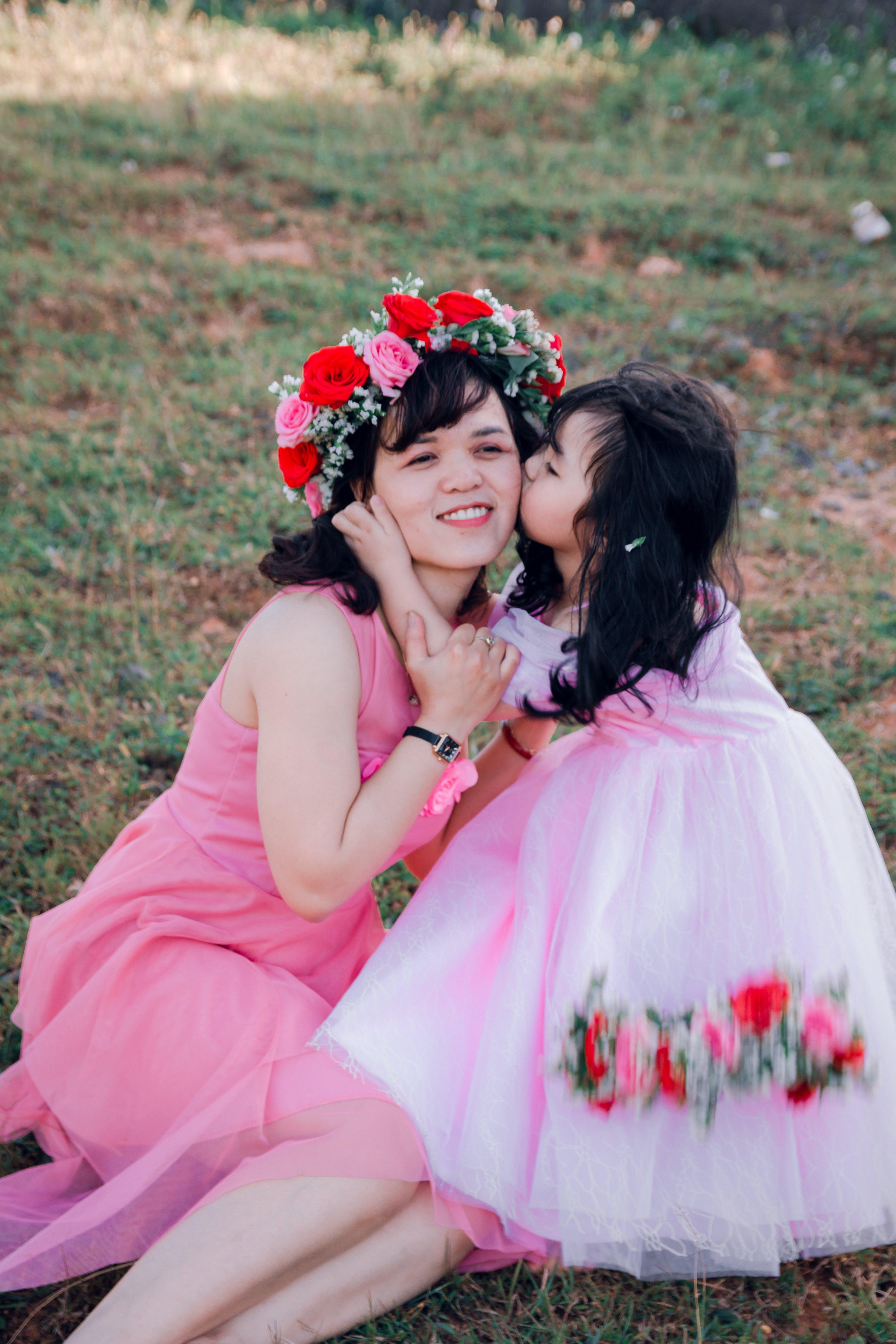 Girl Kissing Woman