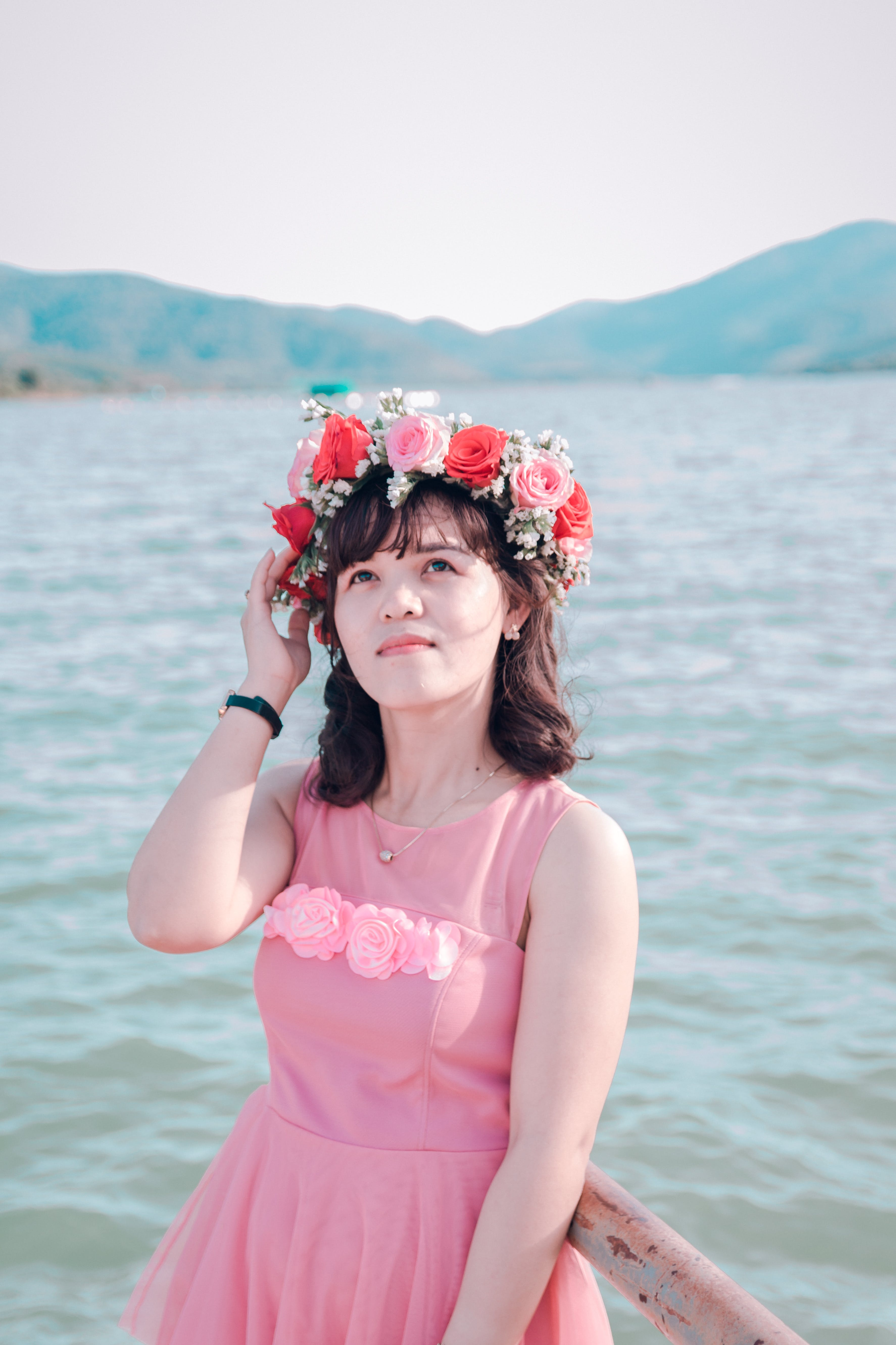 Woman Wearing Sleeveless Dress And Flower Headdress Near Body Of Water