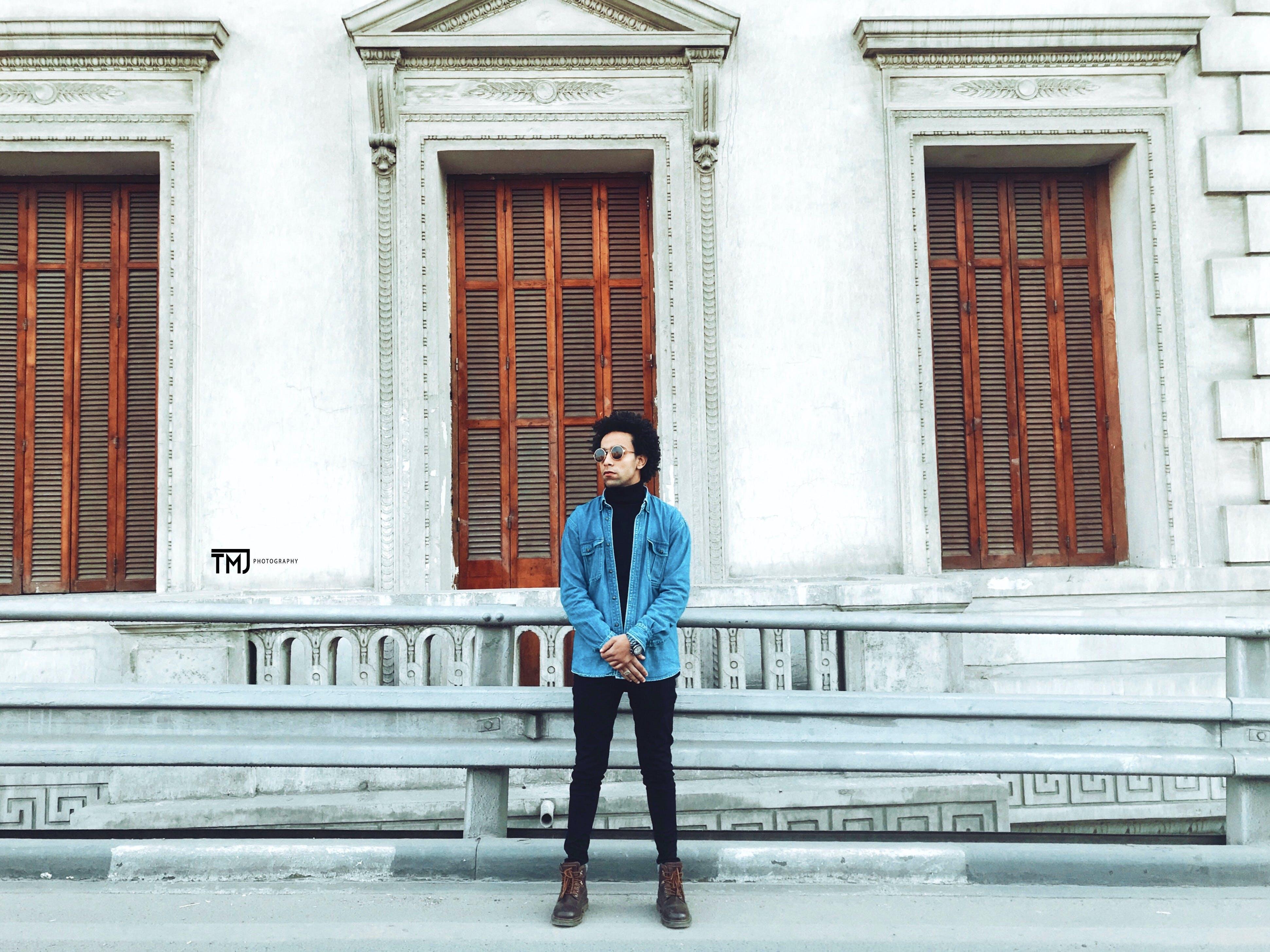 Man Wearing Blue Jacket
