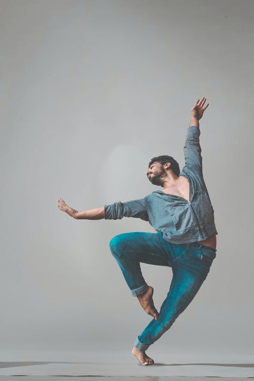 Dancing Man Wearing Pants and Long-sleeved Shirt