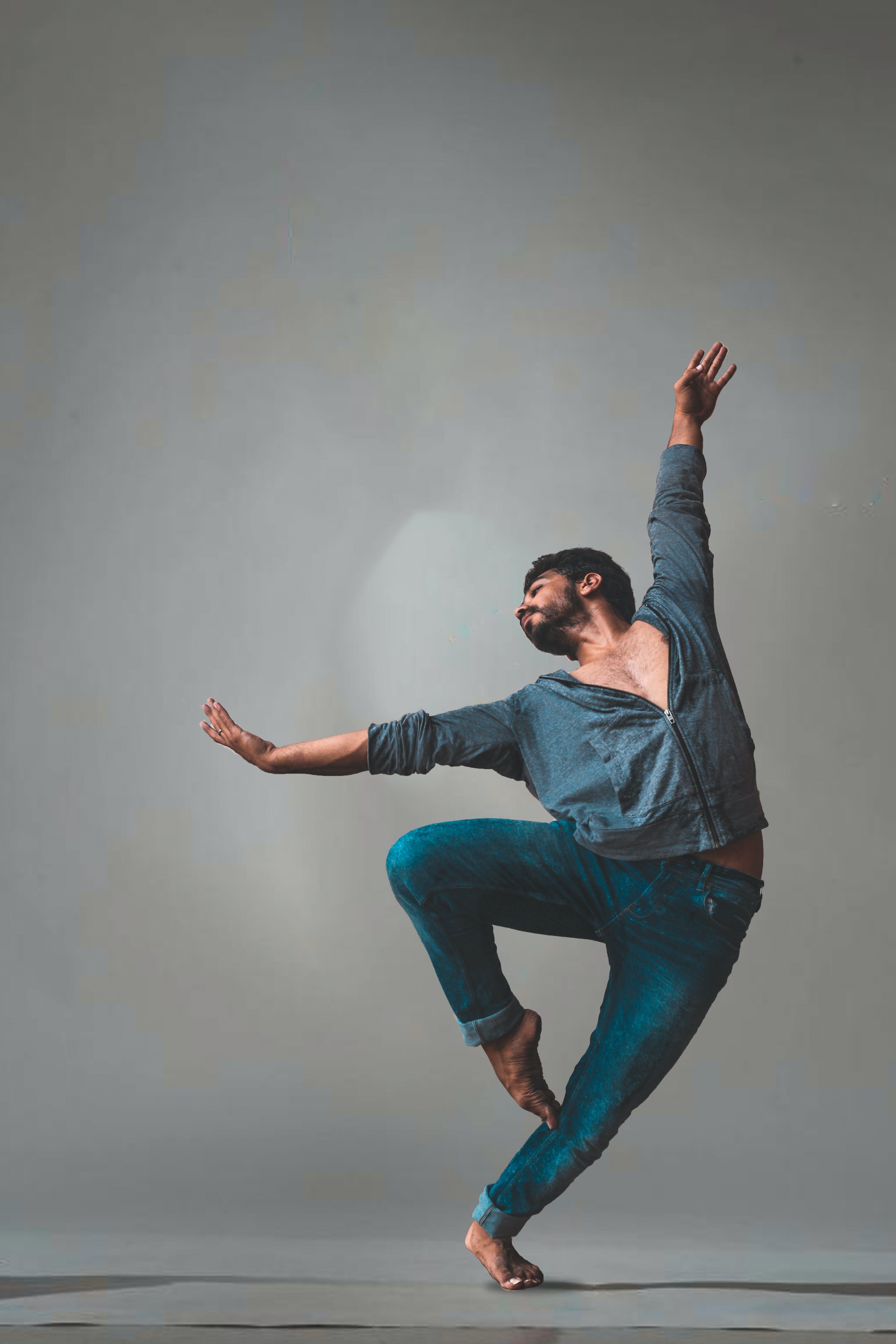 Man Dancing Near White Wall