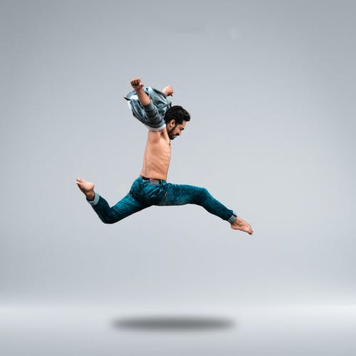 Man Jumping High While Posing