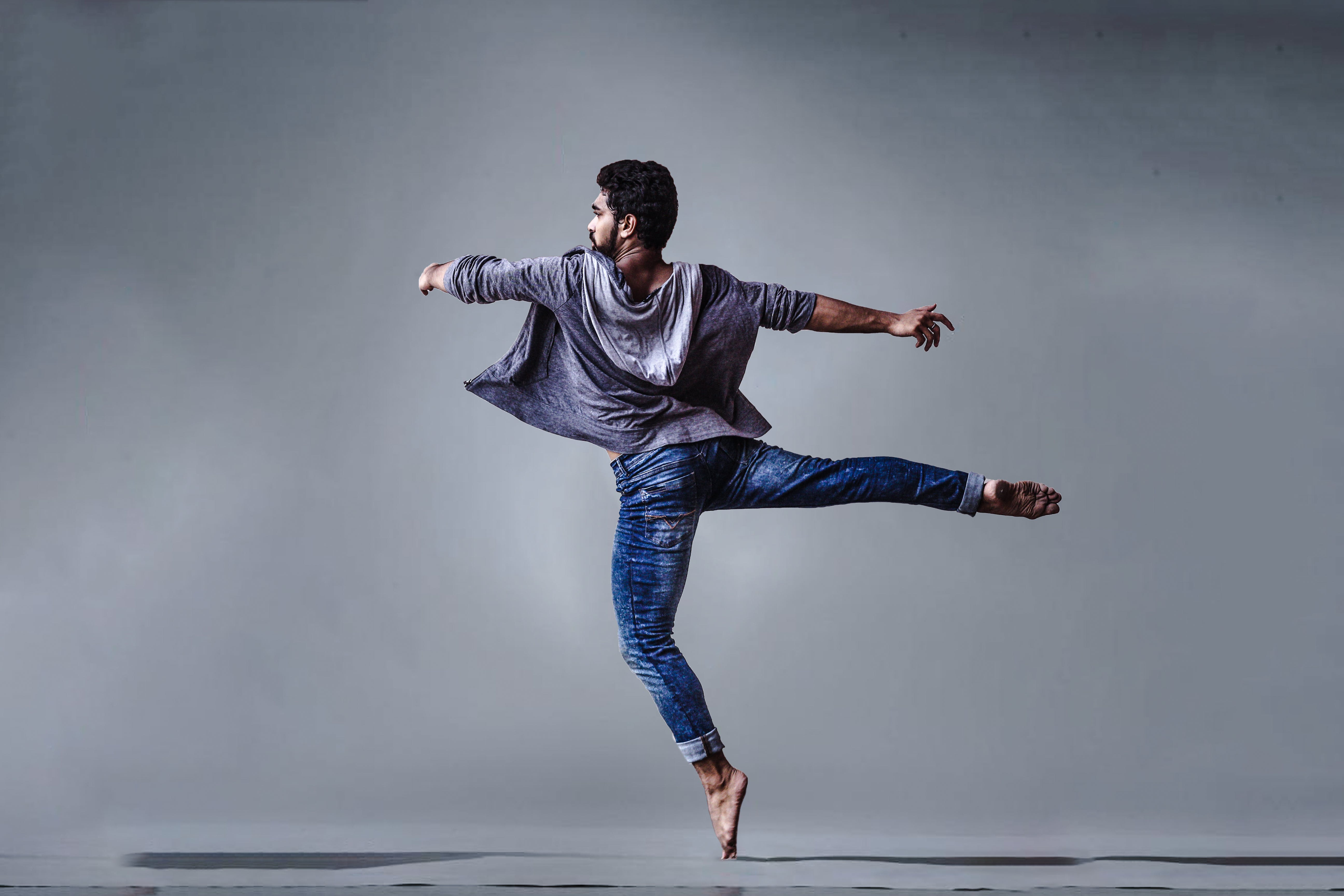 Man Wearing Blue Jeans Doing Pirouette Spin