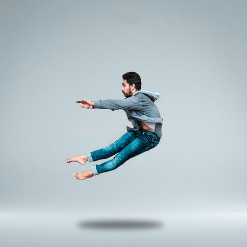 Man Jumping On Mid Air