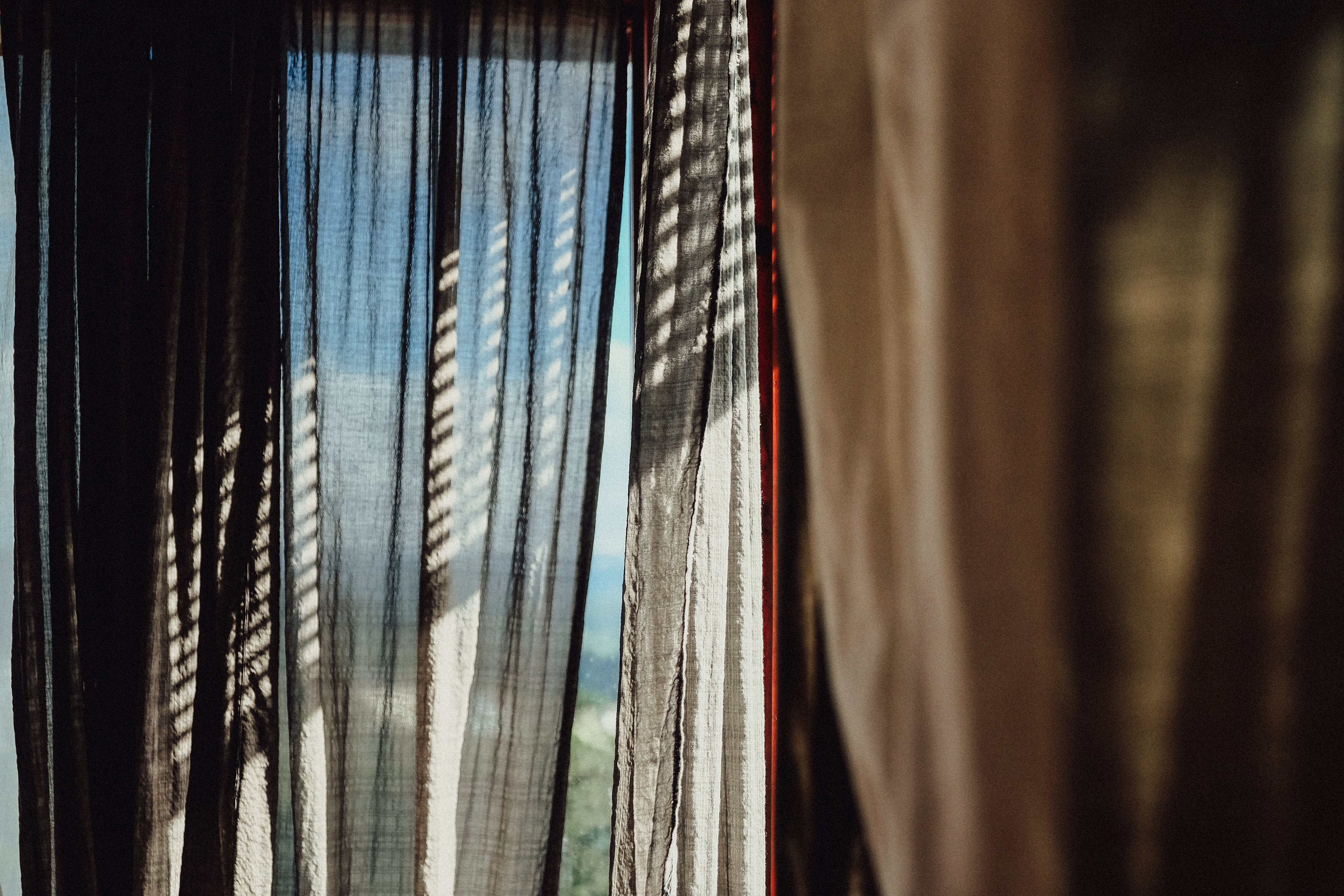 Focus Photography of Brown Curtain
