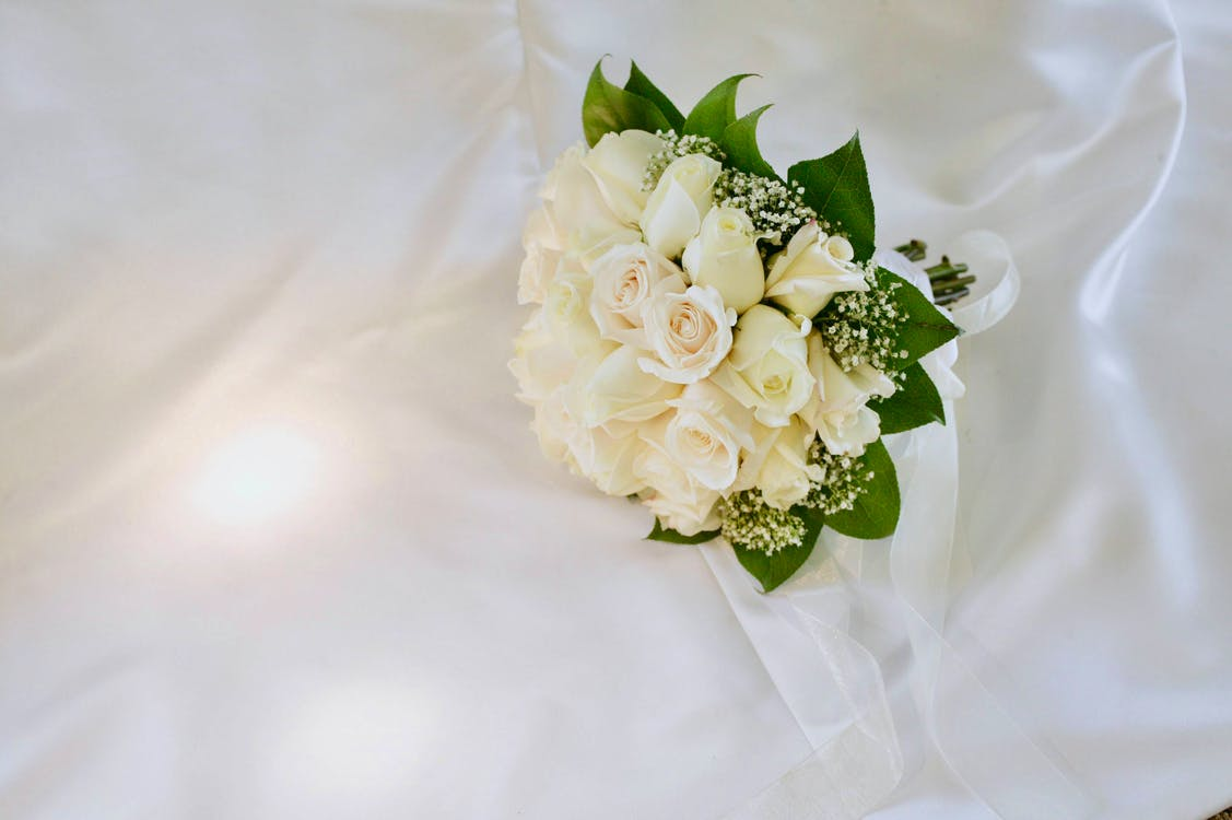 Bouquet of White-petaled Flowers on White Surface