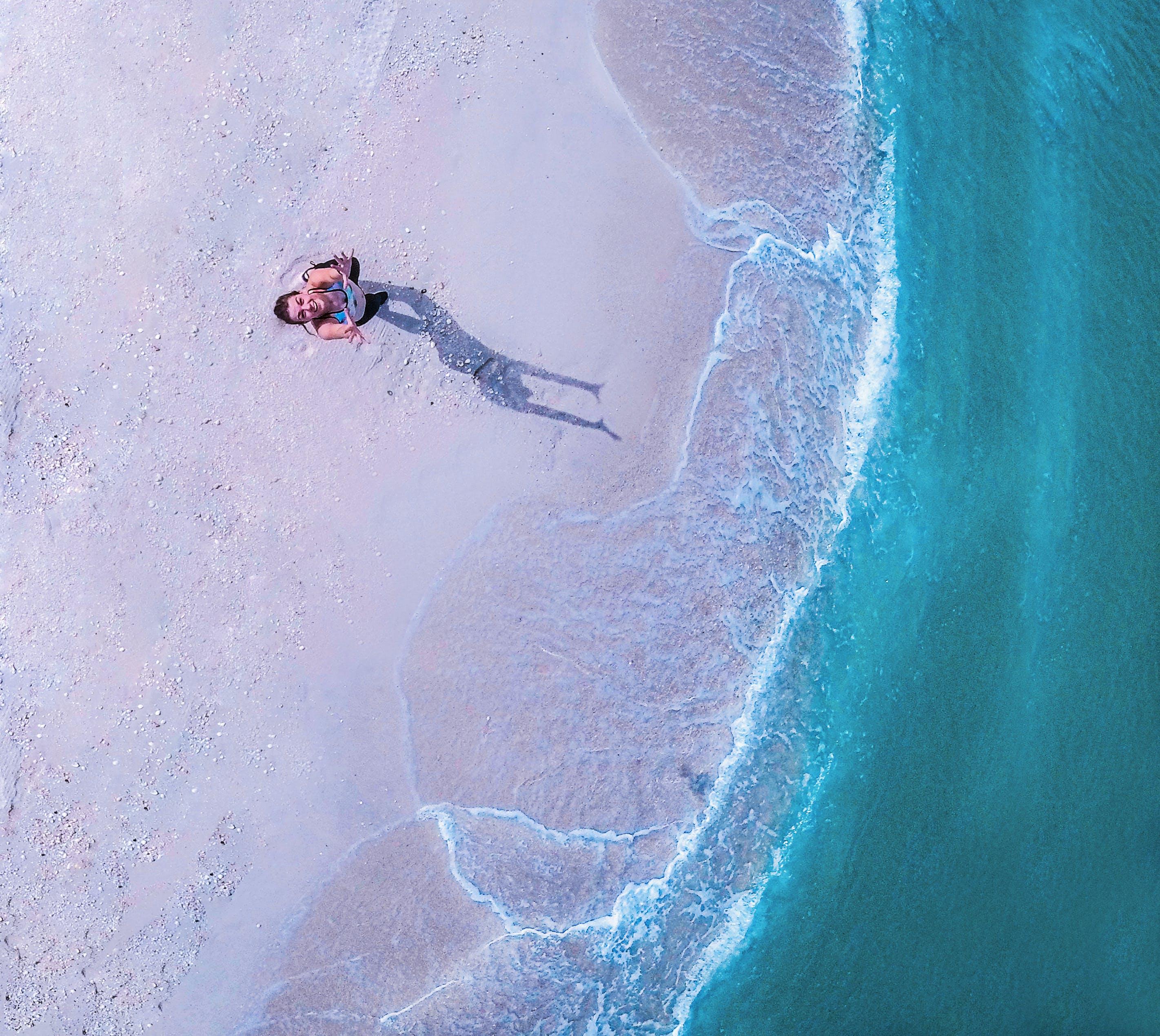 Woman Standing on Beach Line