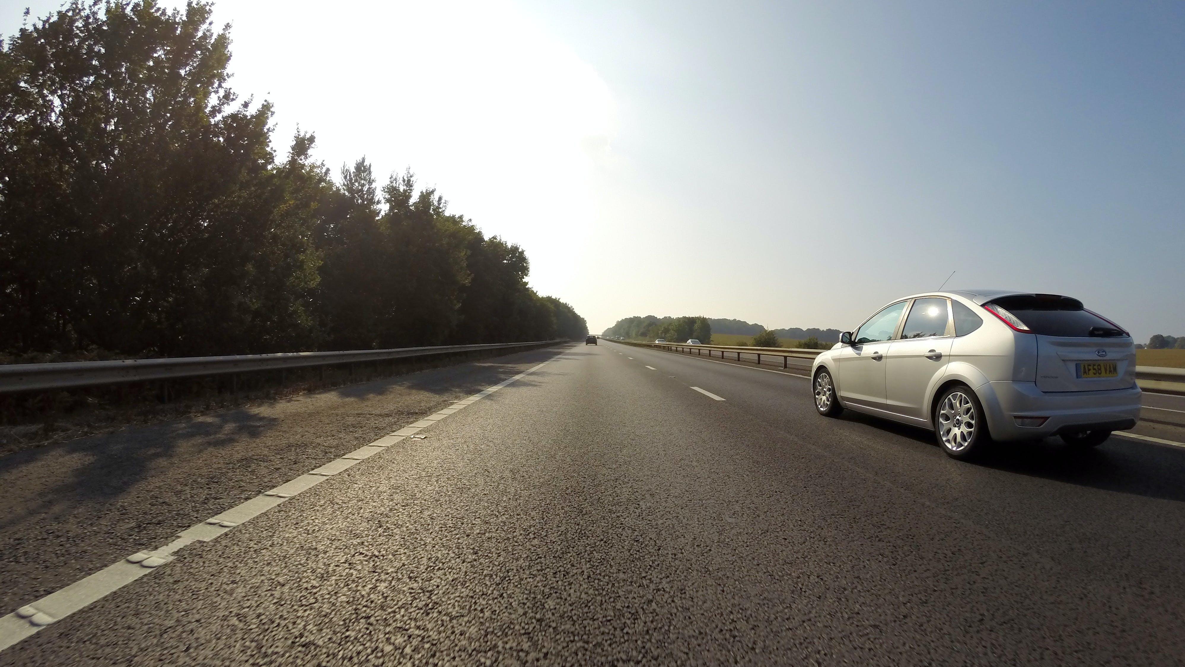 Silver Ford Focus 5-door Hatchback Speeding on Road