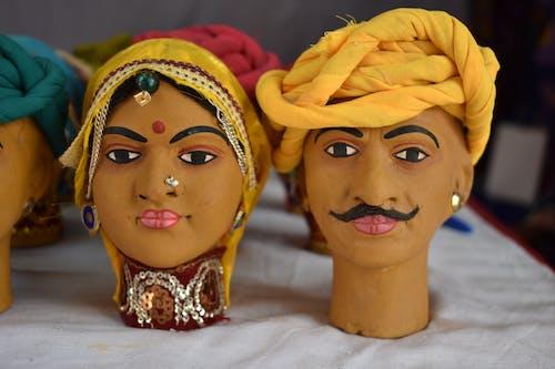 Free stock photo of indian man, man, man and women, Man and Women Sculpture Wearing Rajasthani dress