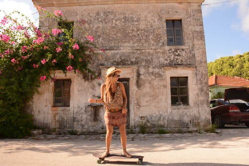 Woman Riding on Skateboard Outdoor
