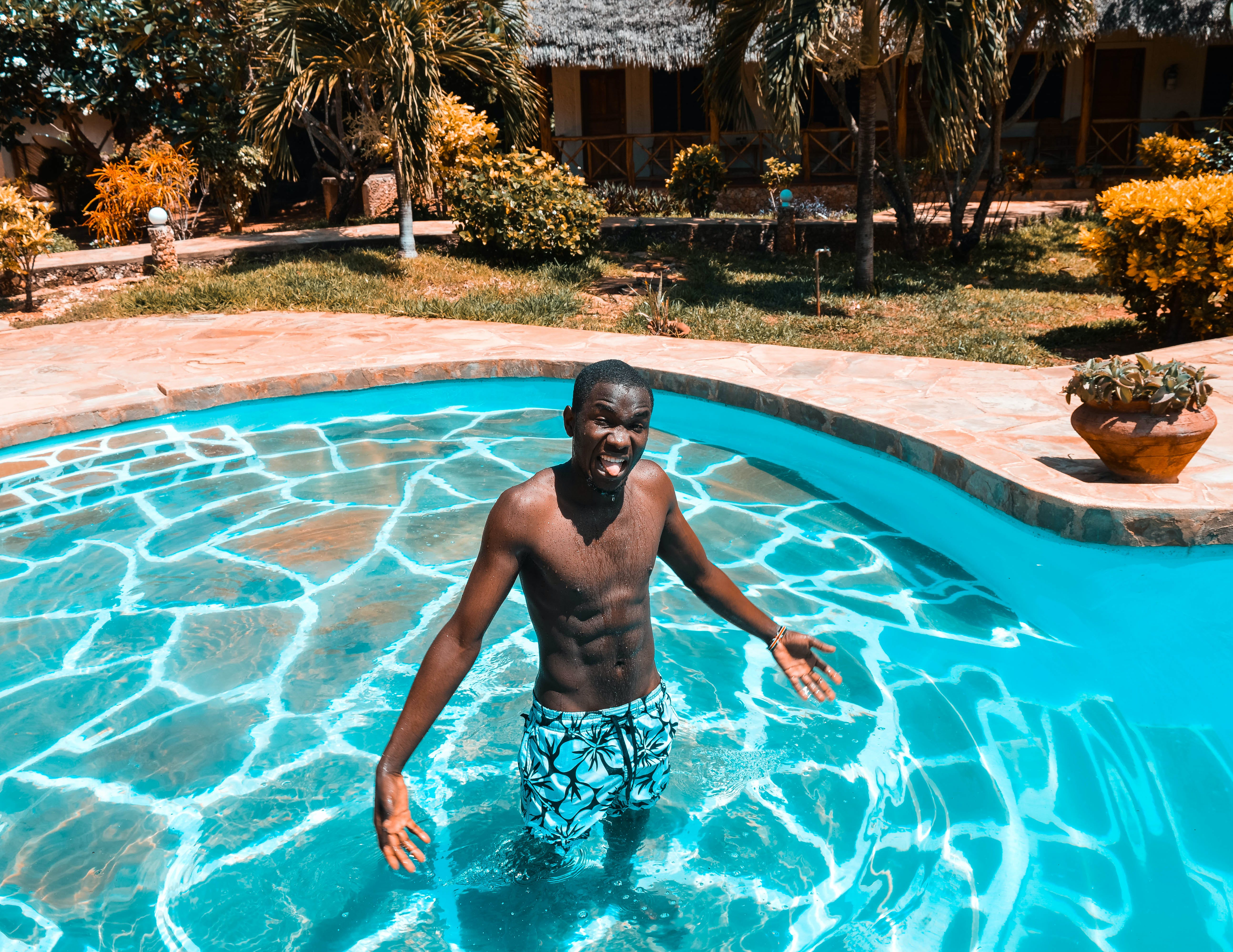 Man In Blue Shorts Standing In Pool