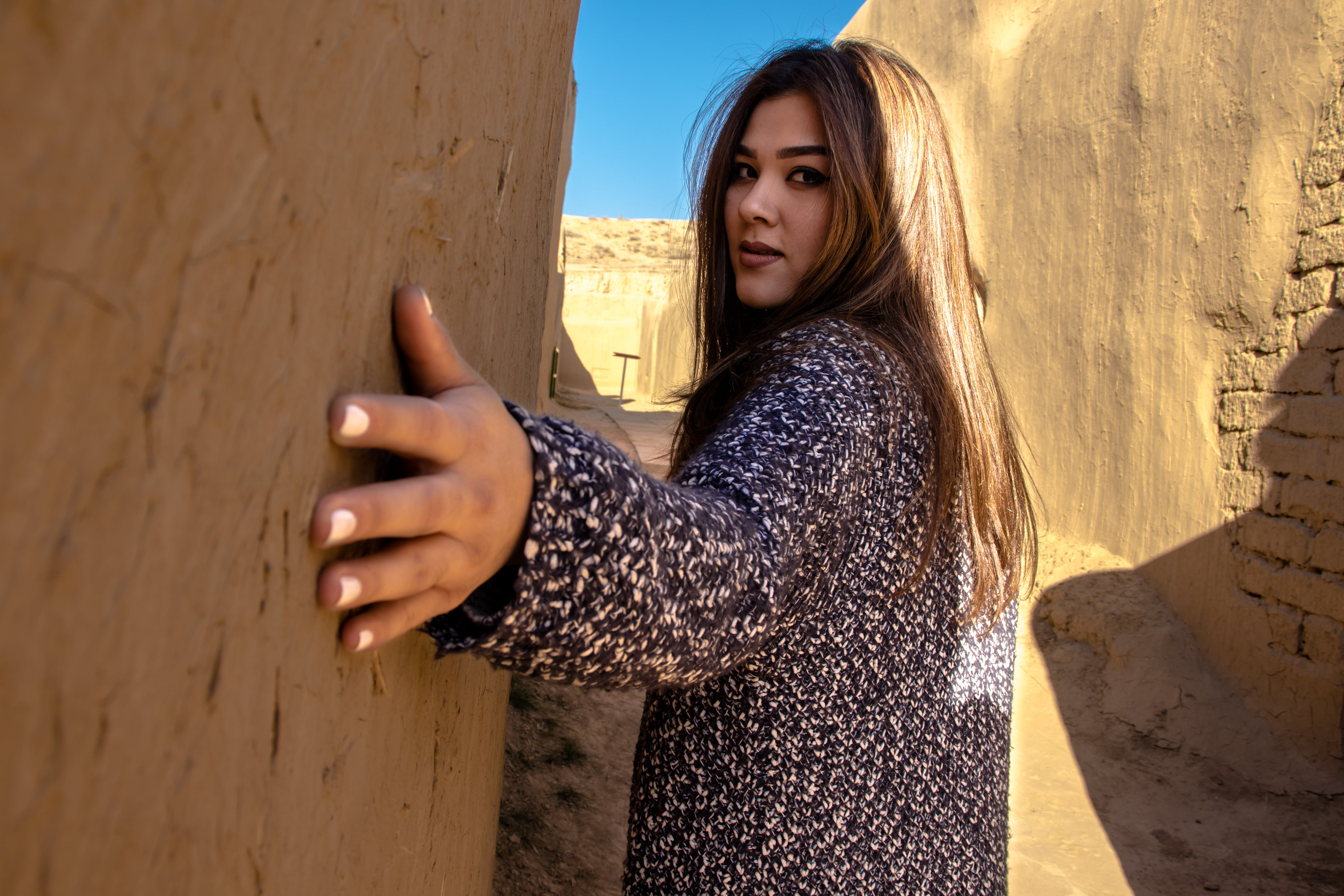 Photo of Woman Holding Wall